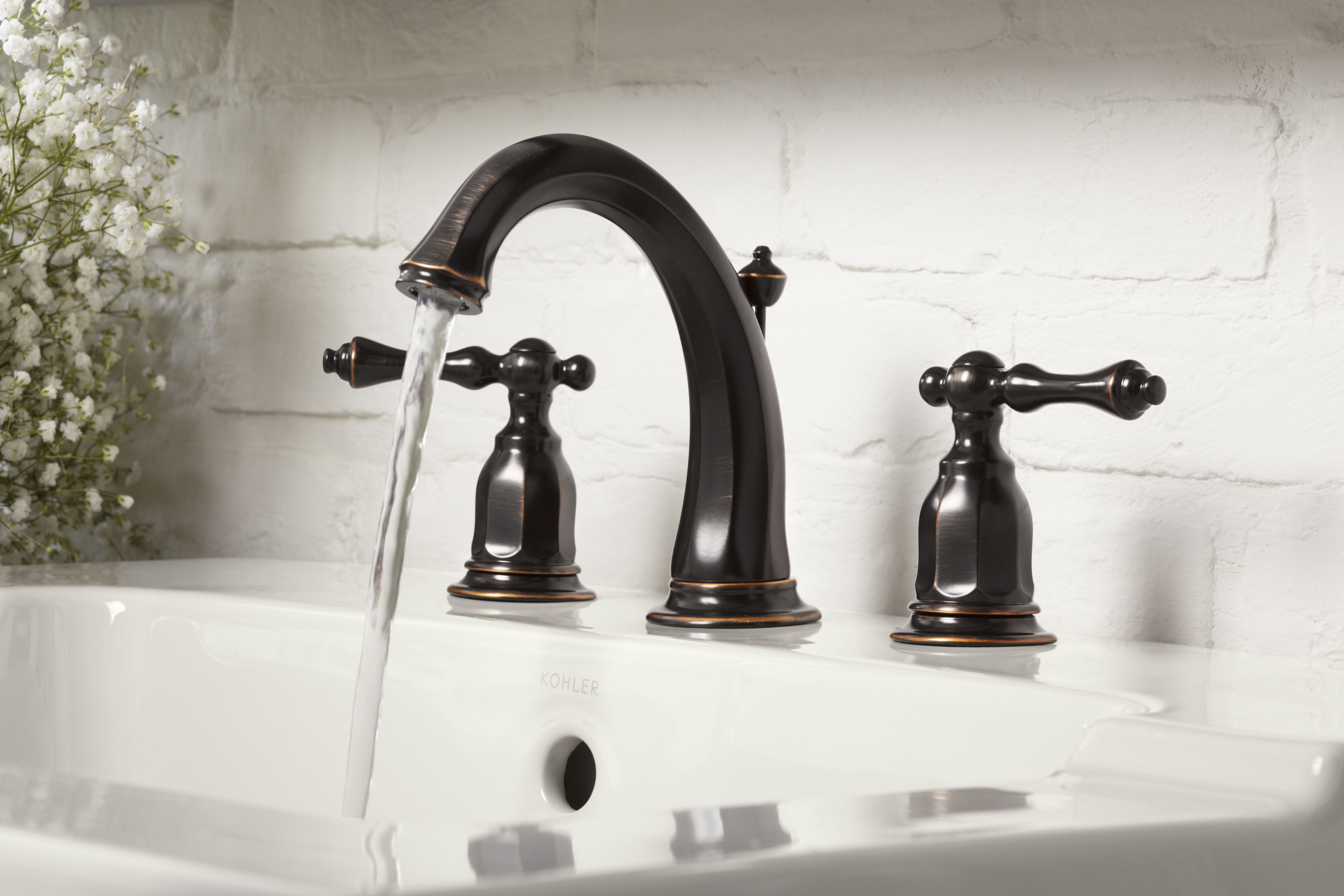 Kelston Faucet     Tresham Sink     The deep color of an Oil-Rubbed Bronze finish highlights the ornate details of a traditional faucet.