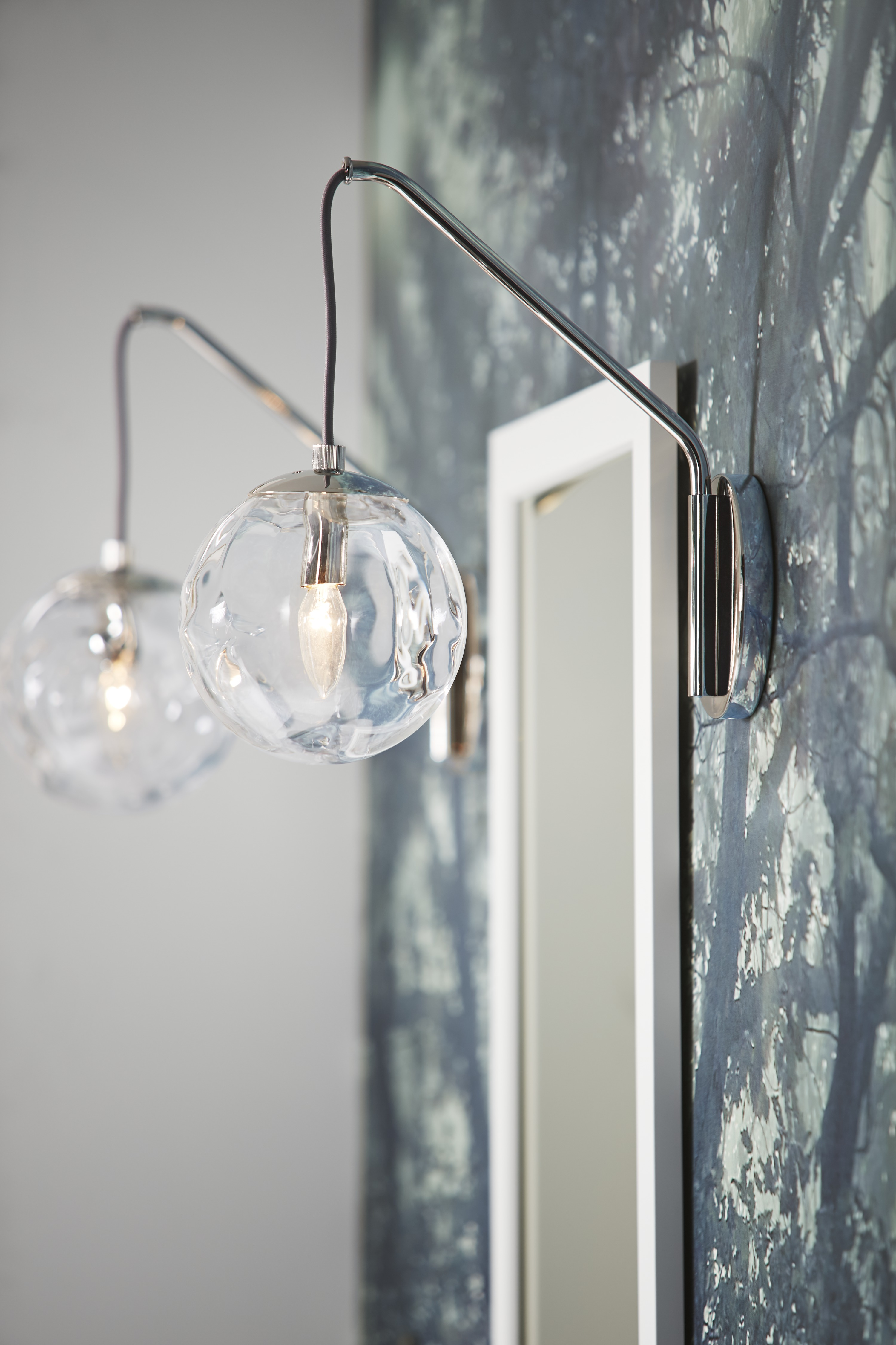 Poplin® mirror     Clear, uniquely hung pendant lights provide an interesting contrast to a sleek, simple mirror.