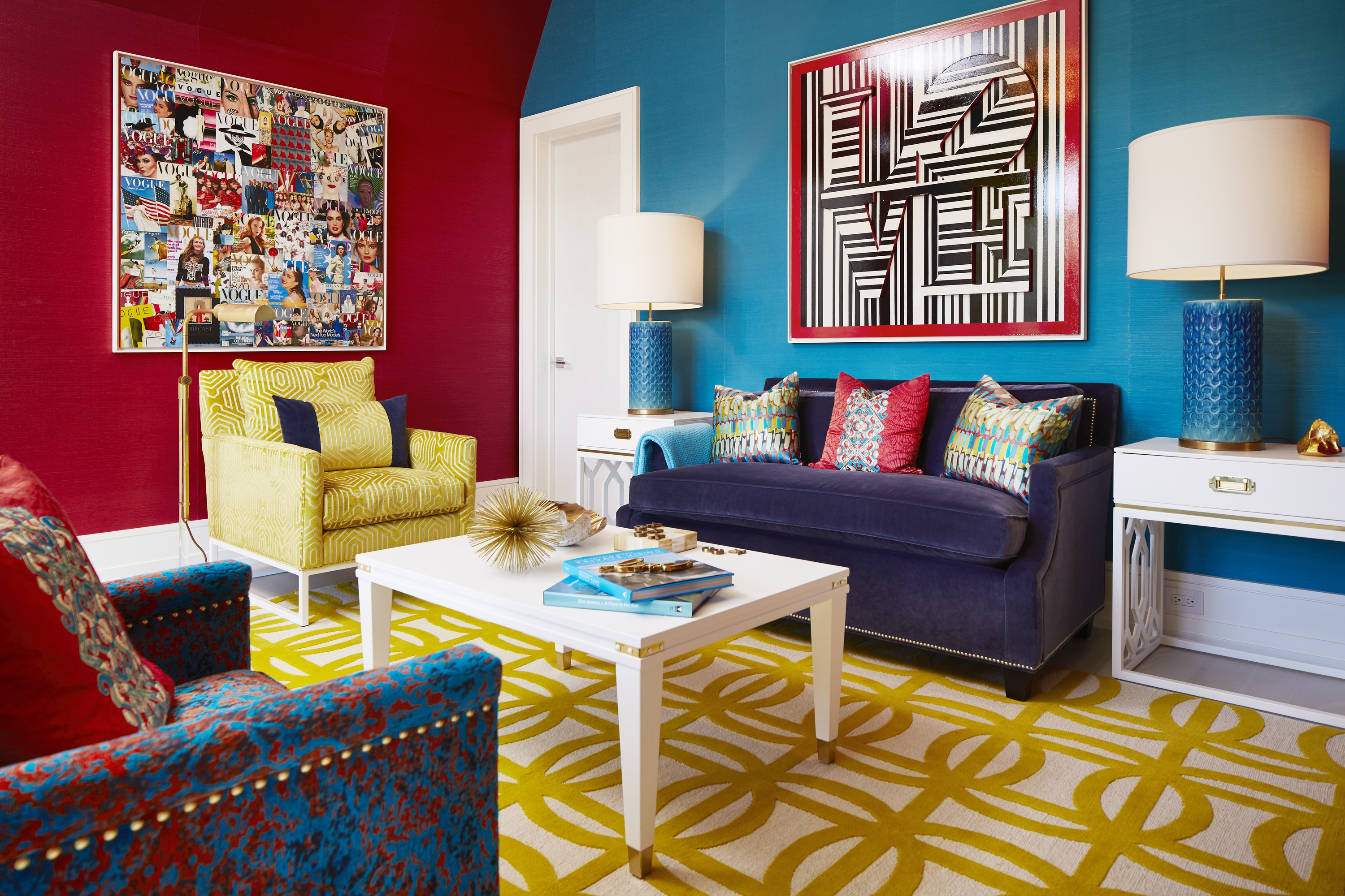 In the home's only truly exuberant dive into color, the upstairs sitting room is awash in vibrant blocks of blue, red and yellow, not to mention a myriad of similarly-hued patterns.