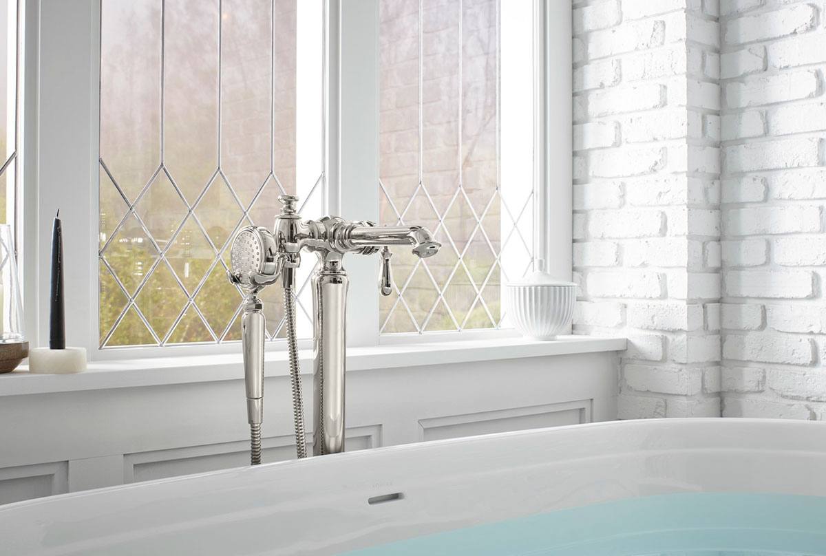 Memoirs Freestanding Bath   Pairing common elements throughout a space punctuates style and personality, while creating cohesiveness. Here, a floor mount bath filler with flume spout imparts a vintage charm portrayed in the fixture collection used throughout the space.