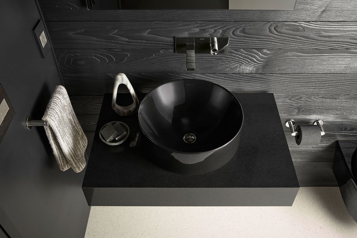 Vox Round Vessel Sink    Composed Faucet   A round vessel-style sink and single handle faucet bring sleek style and function to the space.