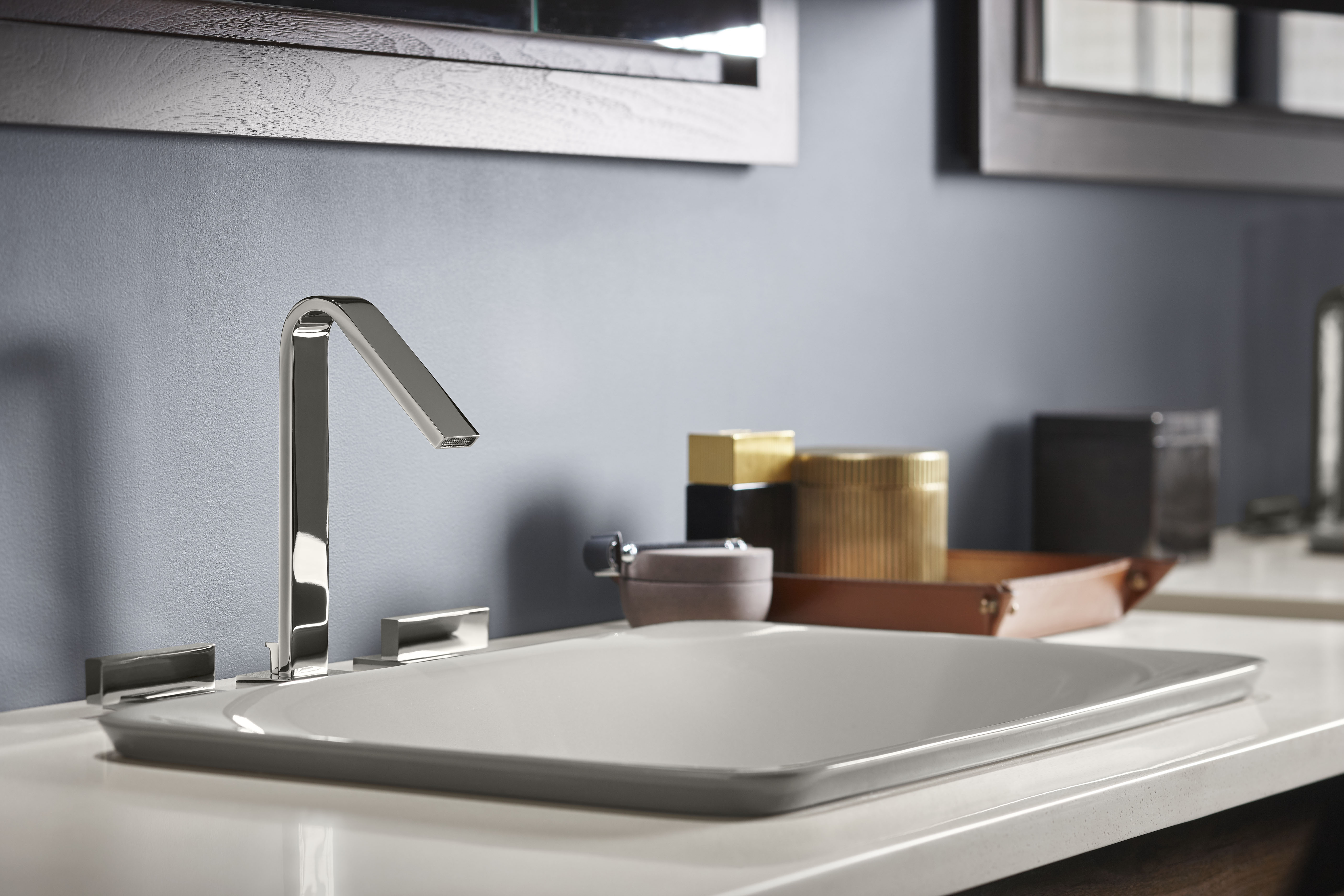 Loure Faucet     Carillon Sink     The Vibrant Polished Nickel finish on this sleek faucet picks up light adding an inviting touch to this crisp, modern environment.