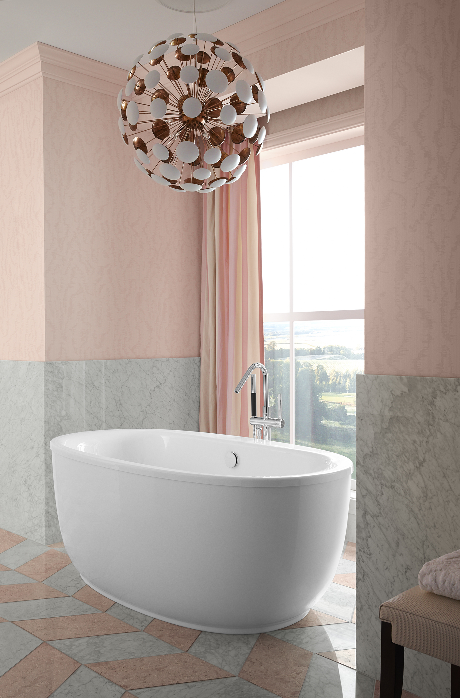 Stillness® bath filler   Sunstruck® bath     ANN SACKS® Carrara field tile     Set into a sunny alcove, a separate bathing nook invites calm respite with an oval, ergonomically designed bath.