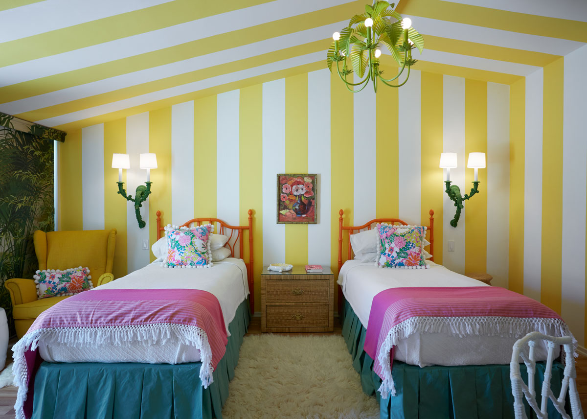 The Lily Pulitzer guest bedroom's bright stripes and floral accents is a cool respite from the desert landscape.