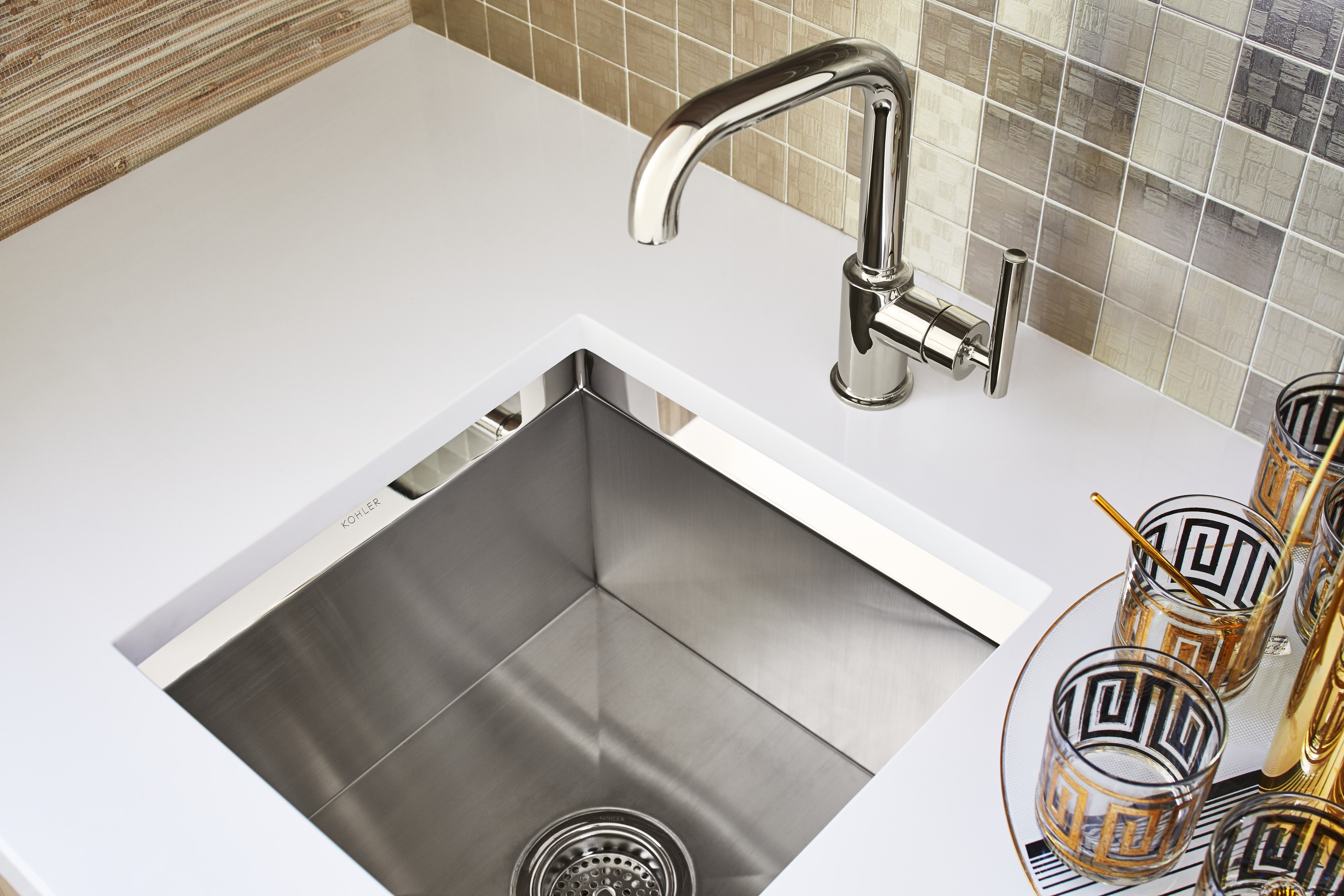 Purist Faucet     Poise Bar Sink     Clean, simple lines can be a bold statement in and of themselves, but paired with the sink's two-tone finish, they give this wet bar its signature elegance.