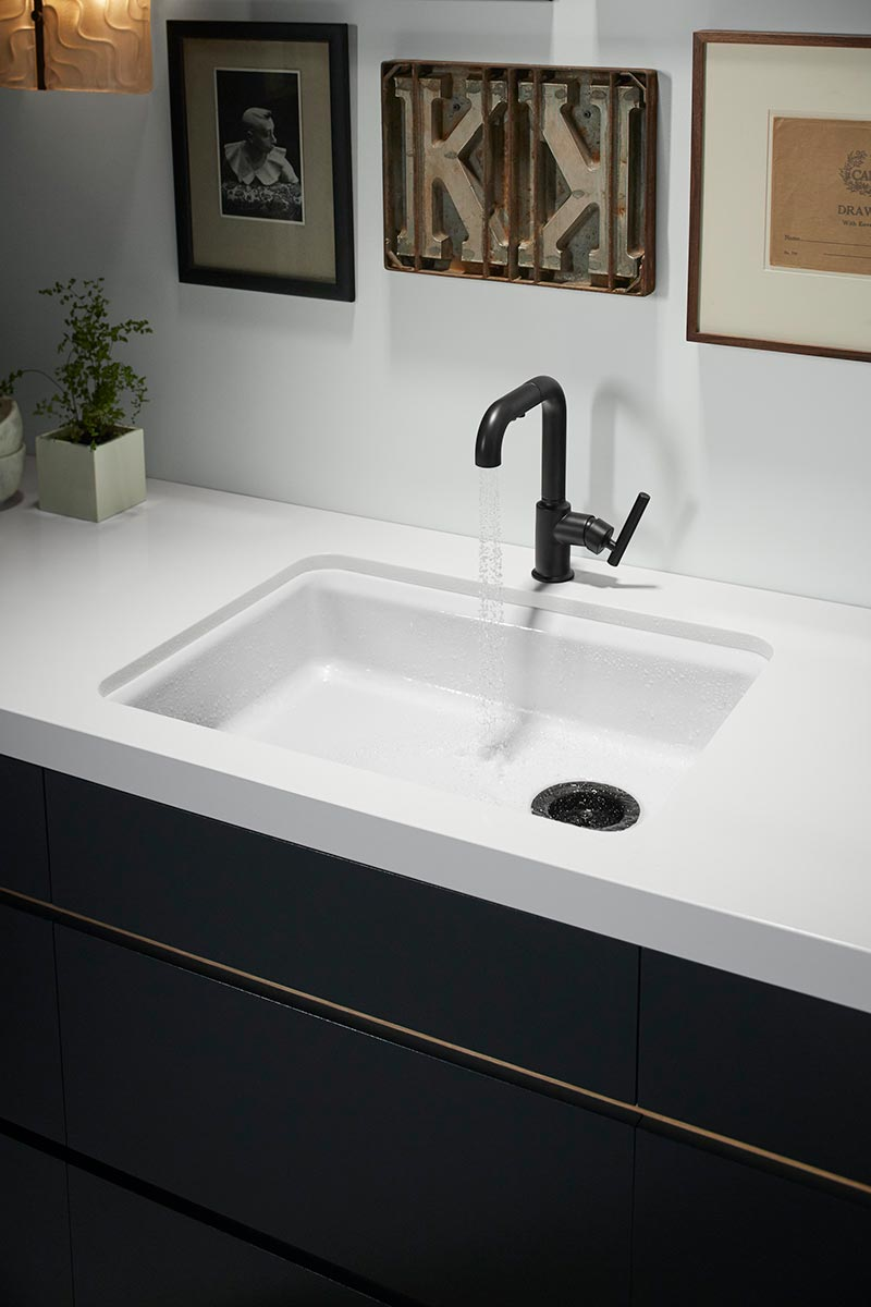 Riverby Bar Sink     Purist Faucet     Chalk White 2126-70      An open bar nook adjoined to the kitchen features a pullout faucet and durable castiron sink  that give this city apartment an extra boost of versatility for tasking or for entertaining guests.