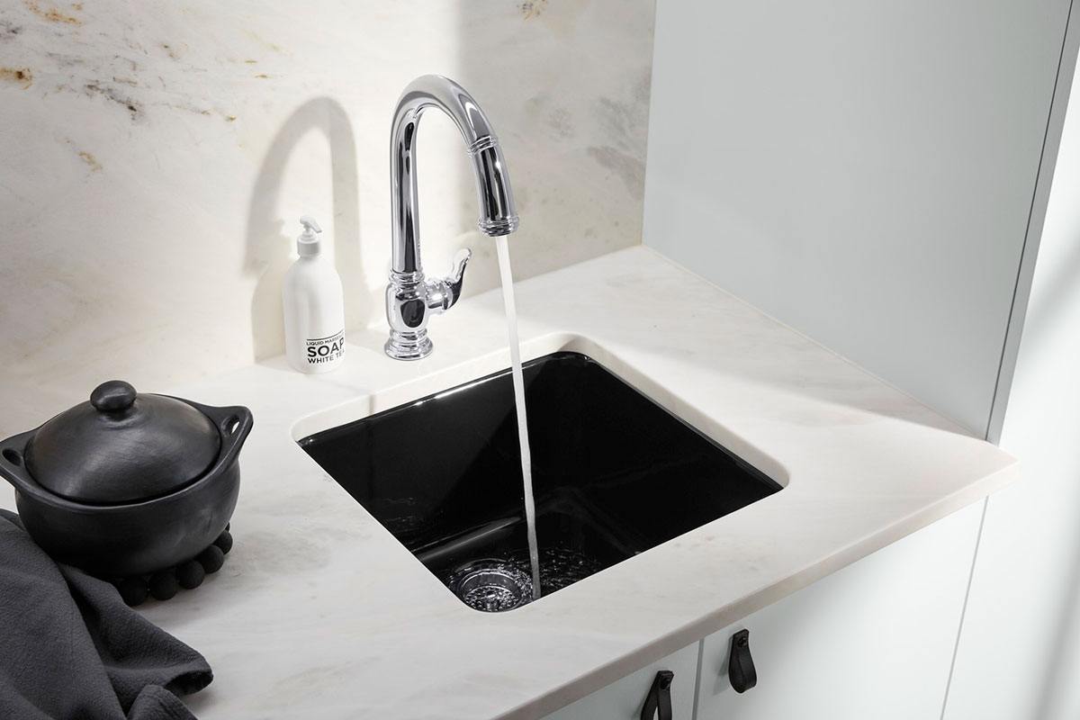 Iron/Tones Bar Sink   Beckon Faucet    An under-mount bar sink maximizes space with its deep basin providing more room for cleaning drinkware.