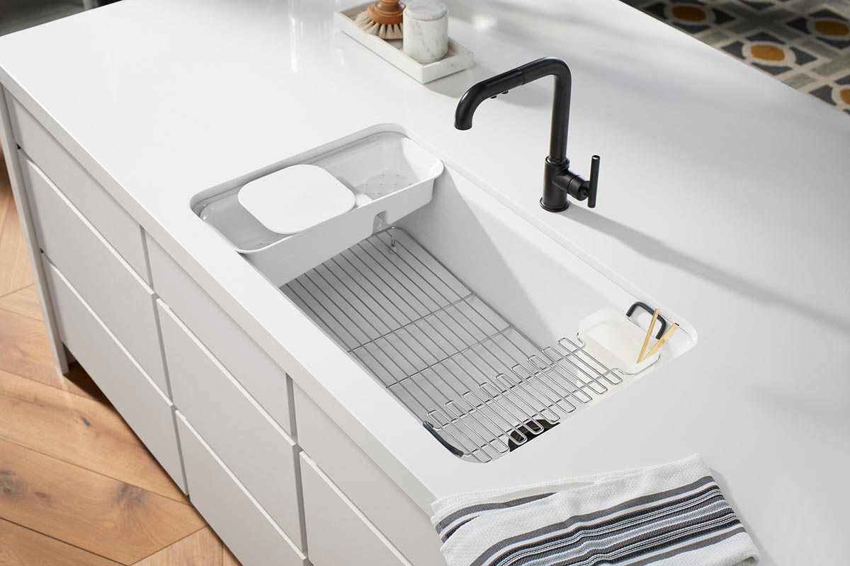 Purist Faucet     Riverby Sink     Silestone Iconic White Countertop      A quietly understated sink brims with savvy functionality including a utility rack for organization, and a sleek faucet that pulls out for more control when rinsing and washing.