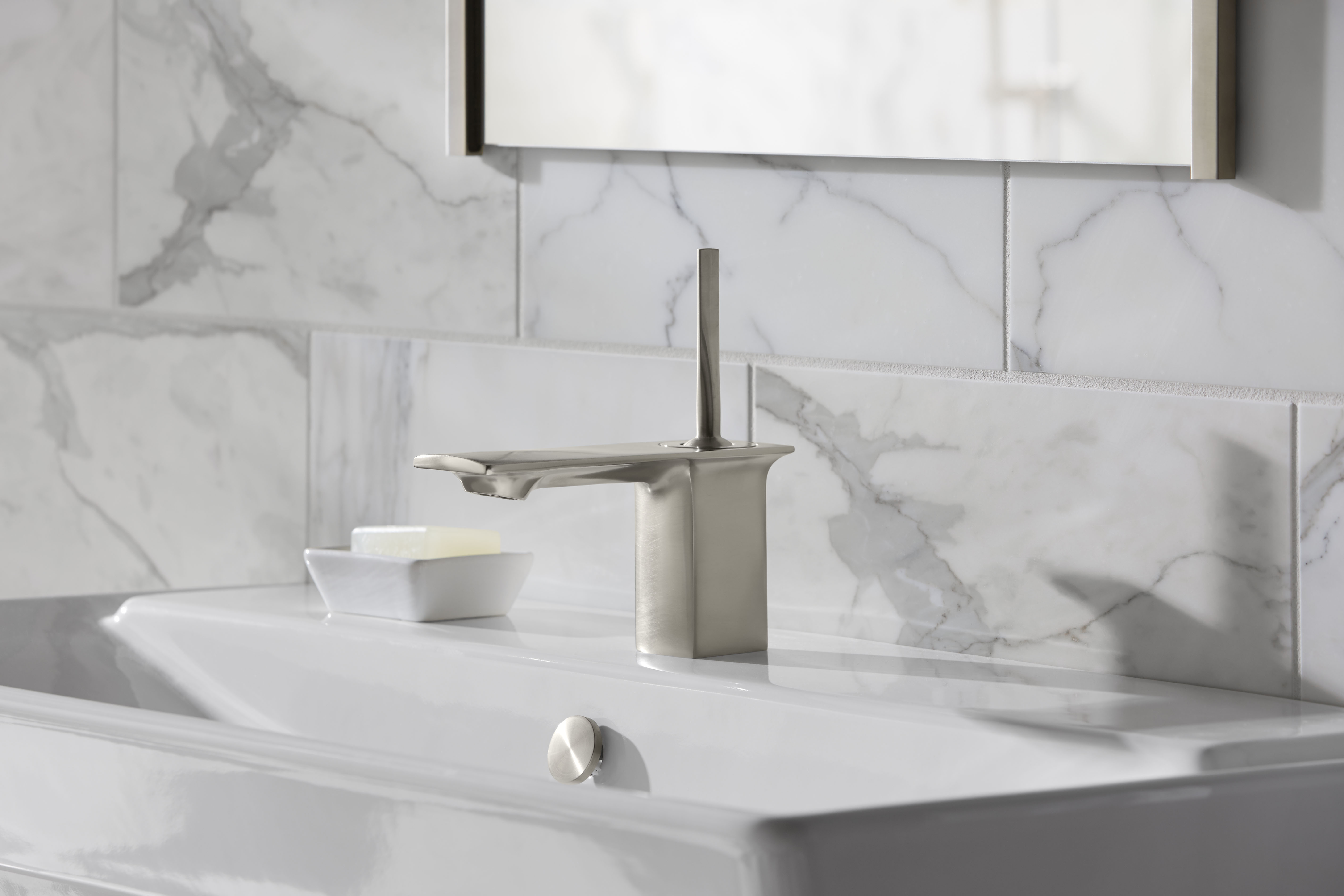 Reve Sink     Stance Faucet     A Vibrant Brushed Nickel finish has neutral tones that can complement classic marble walls and make a modern faucet feel timeless.