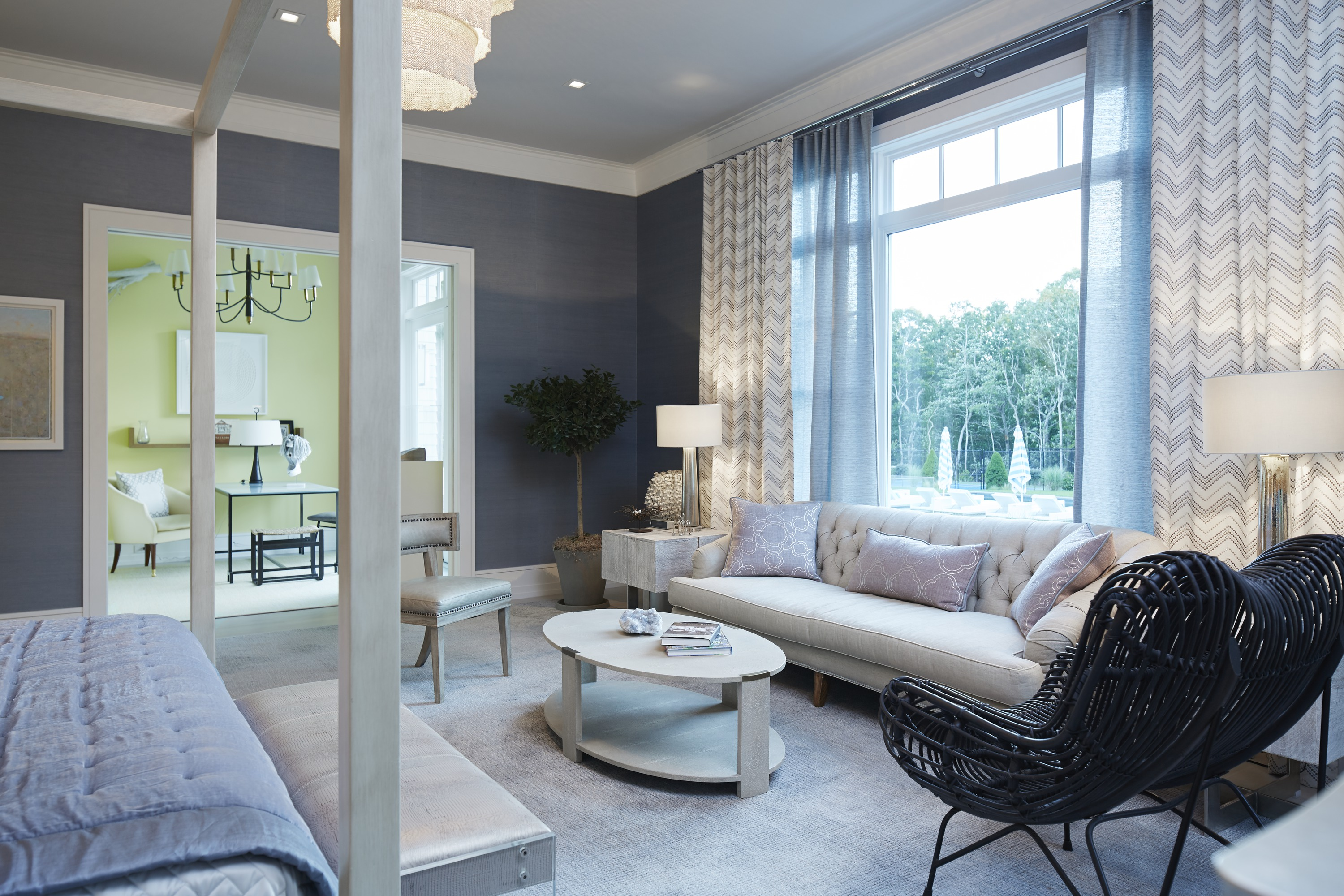 Adjoining the master bedroom, the sitting room by Kyle Roberts looks out to the pool and woods. With cheerful yellow walls, its an ideal spot for planning the day.