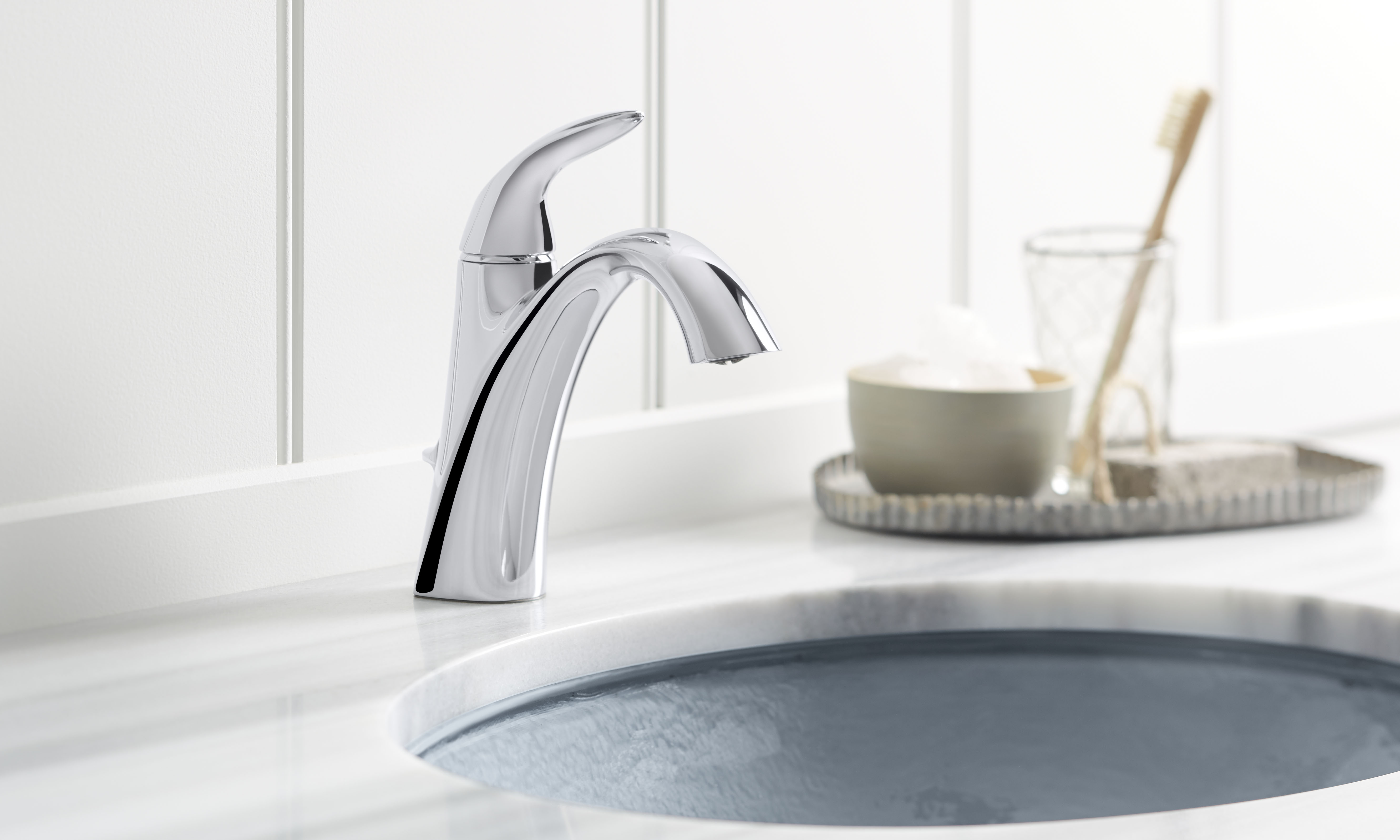 Alteo Faucet     Whist Sink     With its unobtrusive color, this Polished Chrome finish fits in well with the traditional wall panels and modern sink in this space.