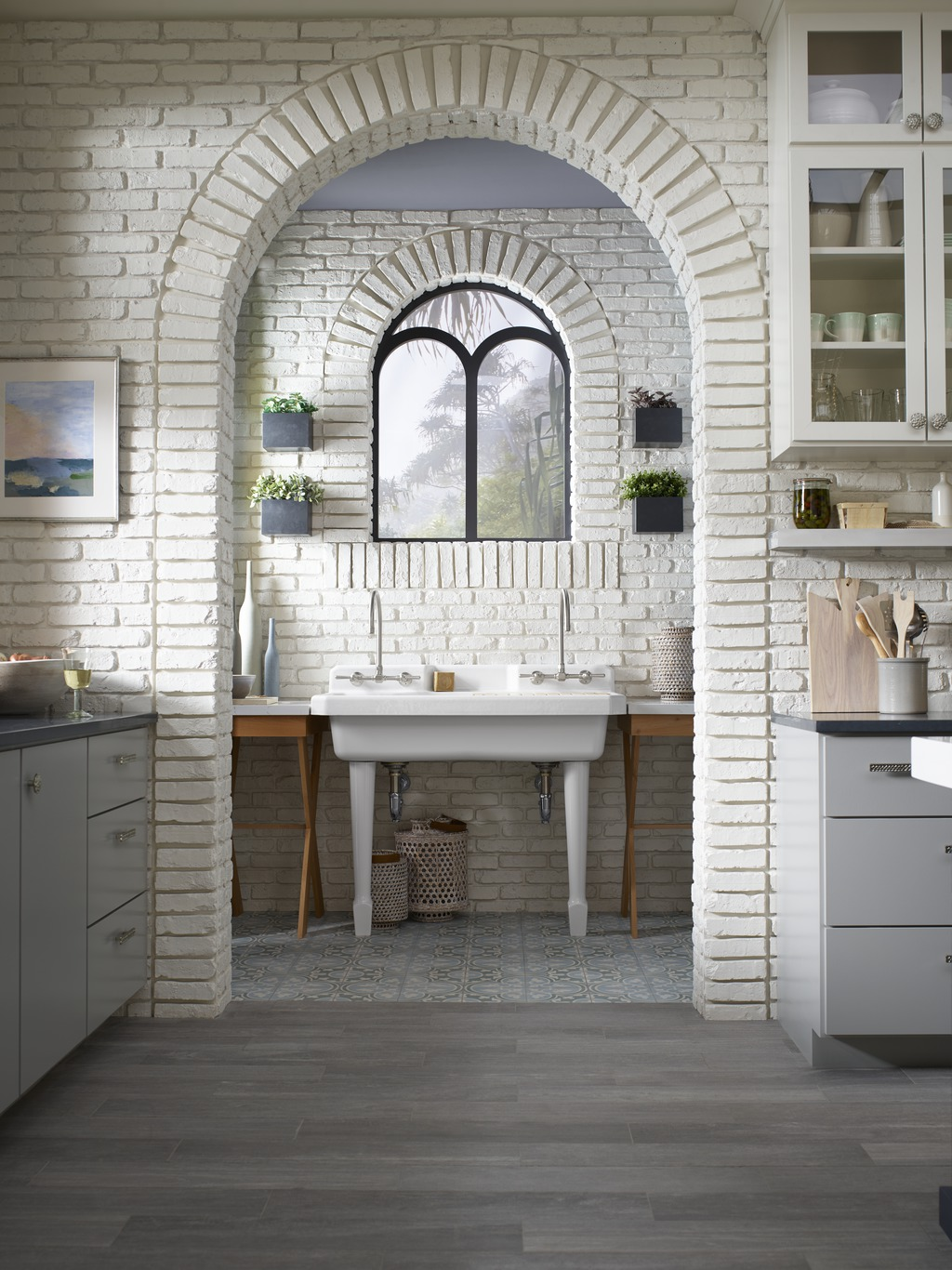 Cloud Cover OC-25     HiRise Wall-Mount Kitchen Sink Faucets     Harborview Utility Sink     Admiring eyes peek through layers of architectural arches and discover the utilitarian beauty of a retro-style laundry sink that flows seamlessly into the design that surrounds it.