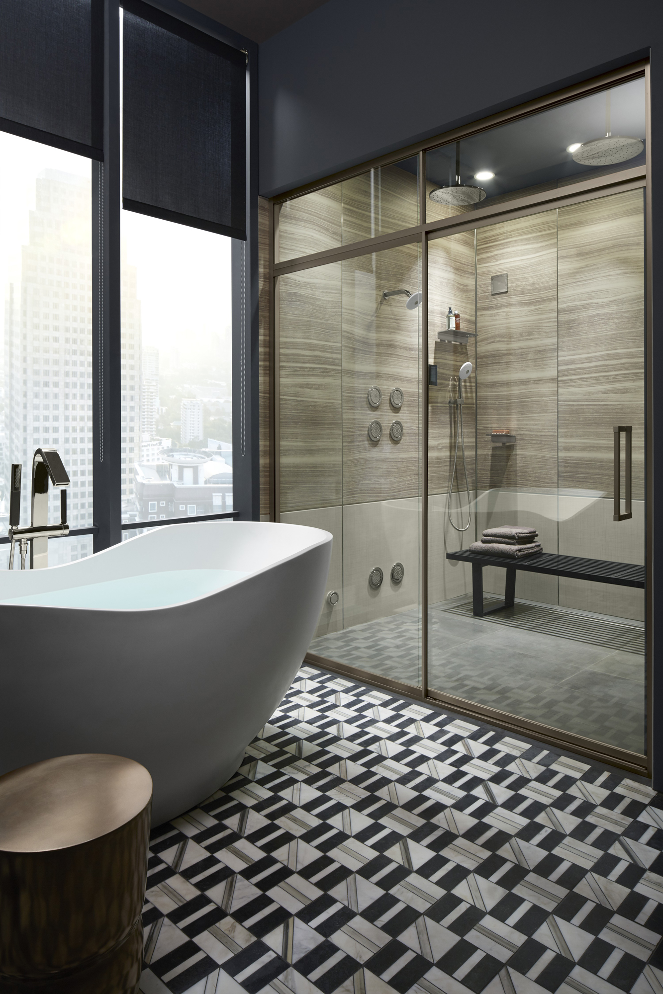 Lattis® shower door   Choreograph® shower walls   WaterTile® body spray     Outfitted with a large two-person shower, this bathroom encourages shared time.