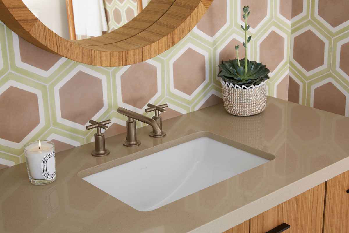 Purist Faucet    Solid/Expressions Vanity Top    Ladena Sink    Jute Vanity         Both the sink basin and faucet spout flaunt their contemporary shapes, adding a cool juxtaposition against the retro wall patterns that surround it.