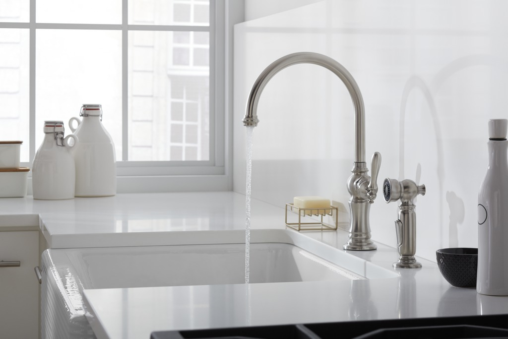 Artifacts faucet and sidespray   Whitehaven sink with Hayridge design   Stainless-steel finishes enhance the character of a white-on-white space with industrial flavor.