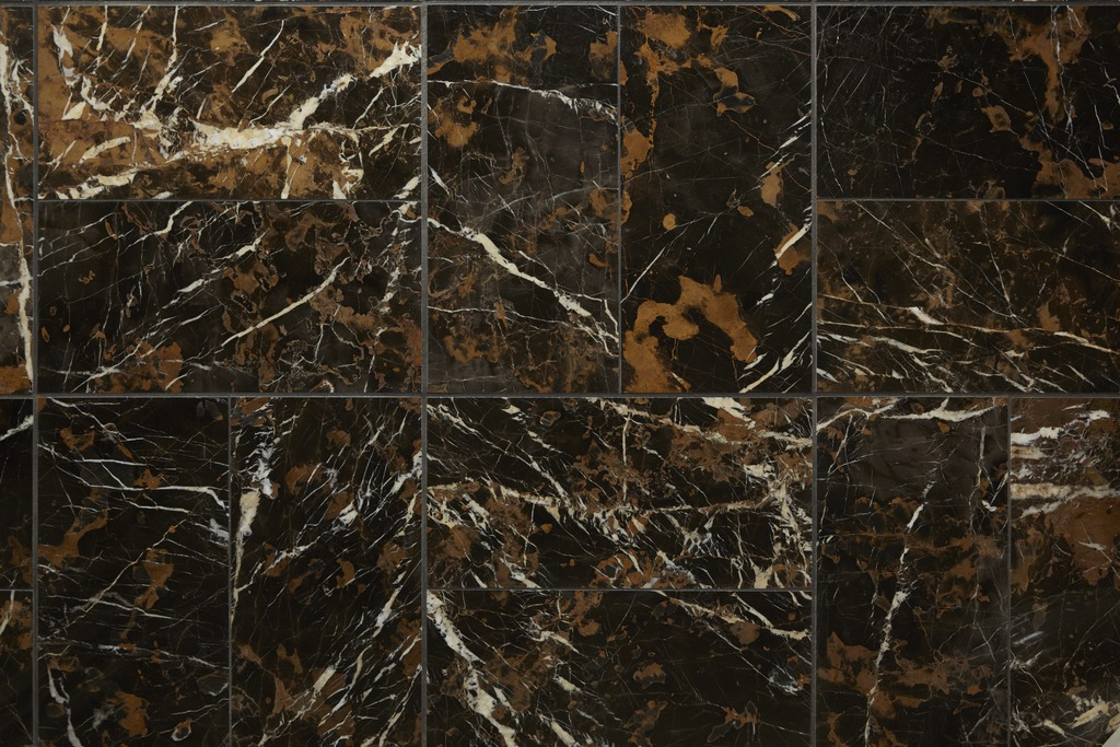 Marble with smoky gold veining adds plenty of visual texture to the flooring.