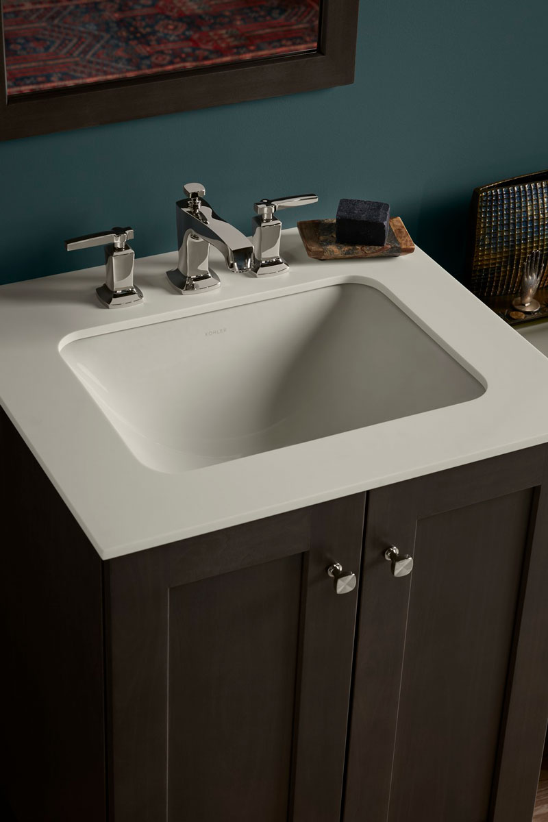 Poplin Vanity    Margaux Sink Faucet    Caxton Sink    Solid/Expressions Vanity Top    Streamlined and elegant, the under-mount sink and vanity top combination creates a smooth counter surface and clean-lined basin.