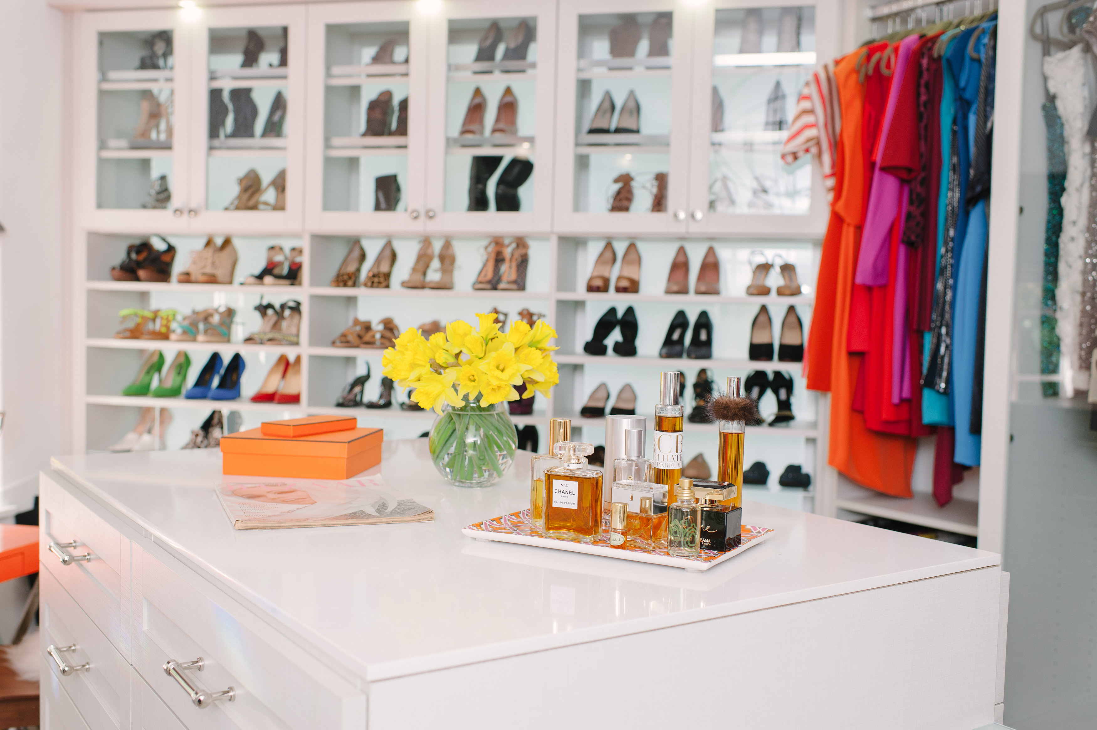 """Thiessen's former office was transformed into a spacious closet and dressing room. """"It's the one room in the house where we wanted to reflect that Tiffani is a glamorous actress,"""" says Lewis. Cabinets and countertops are neutral in this space, by design. """"The clothing in a closet should make the color palette,"""" says Lewis."""