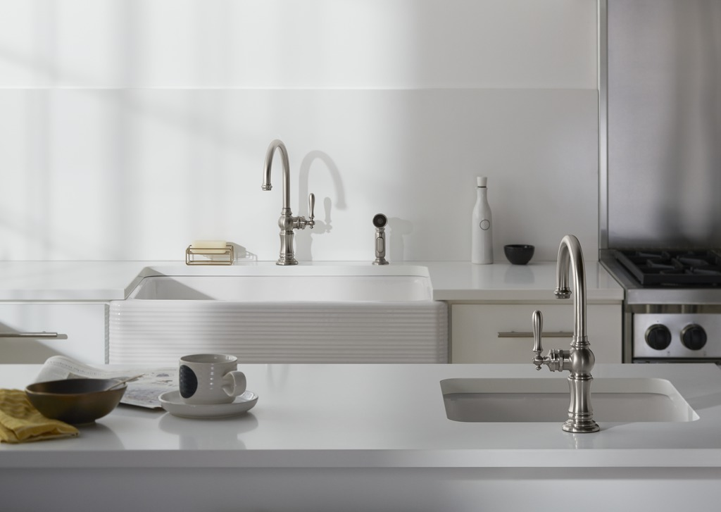 Artifacts faucet and sidespray   Whitehaven sink with Hayridge design   Artifacts single-hole faucet   Iron Tones bar sink   With its tactile horizontal ridges, the apron-front sink is an unconventional take on farmhouse style. The bar sink adds a convenient second prep and cleanup station.