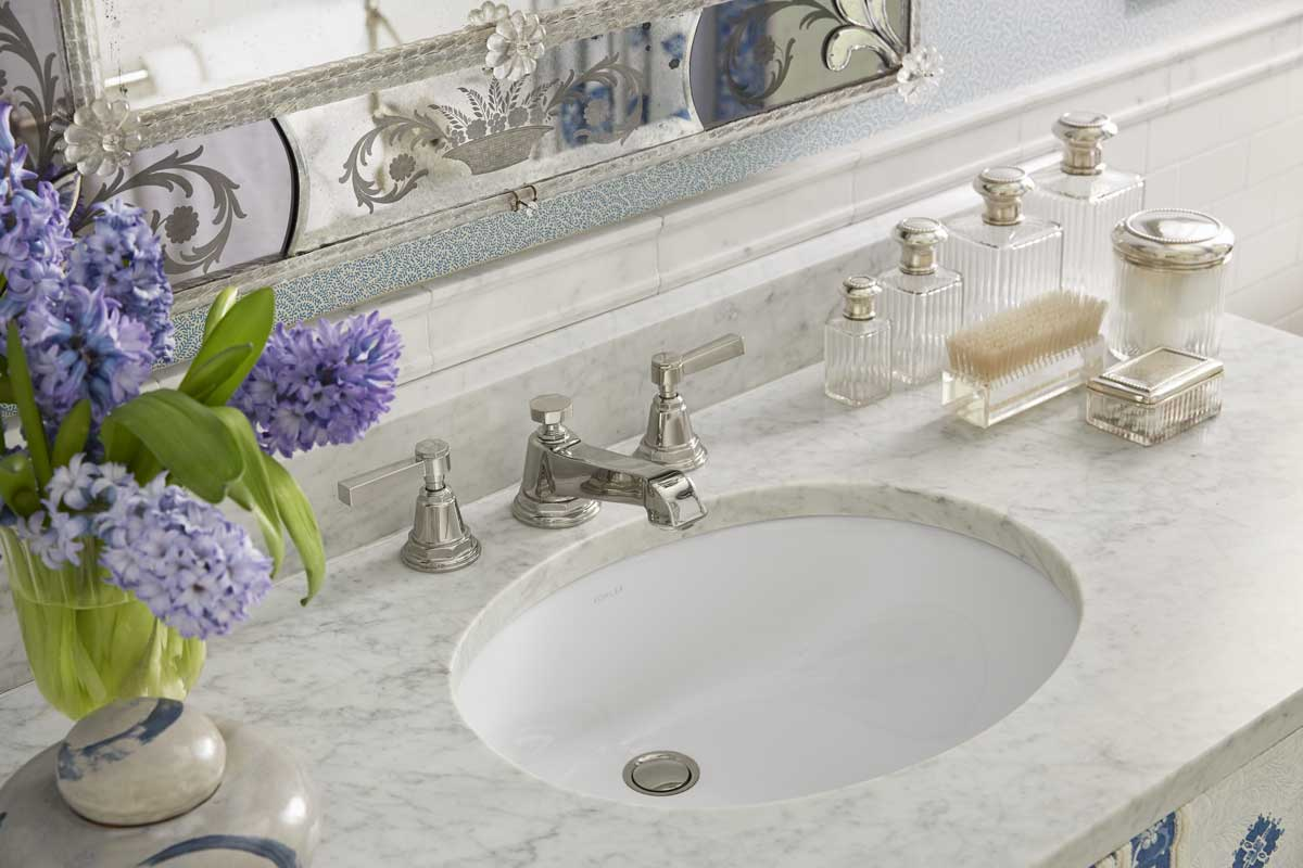 Pinstripe Sink Faucet    Caxton Under-Mount Sink   The Pinstripe sink faucet in a Vibrant® Polished Nickel finish makes sure the bathroom feels as neat and refined as the bedroom beside it.