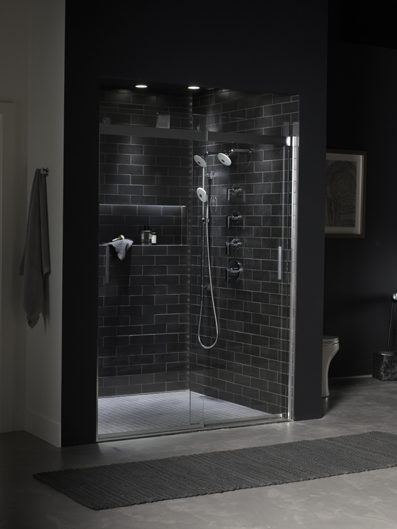 Exhale Showerhead     Exhale Handshower     Levity Shower Door     A matching multifunction handshower and showerheads in white pop against the dark tile shower walls and deliver four different sprays for custom experiences.