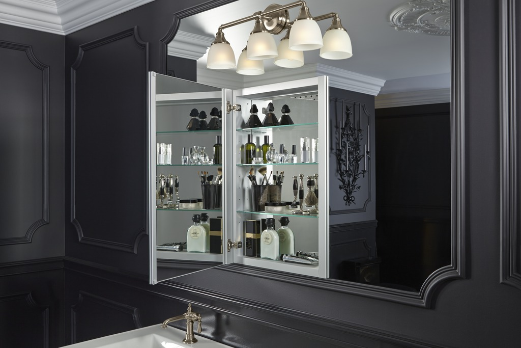 Devonshire wall sconce   Verdera medicine cabinet   Artifacts faucet   The right lighting and storage makes a merely beautiful bathroom into a completely convenient one.