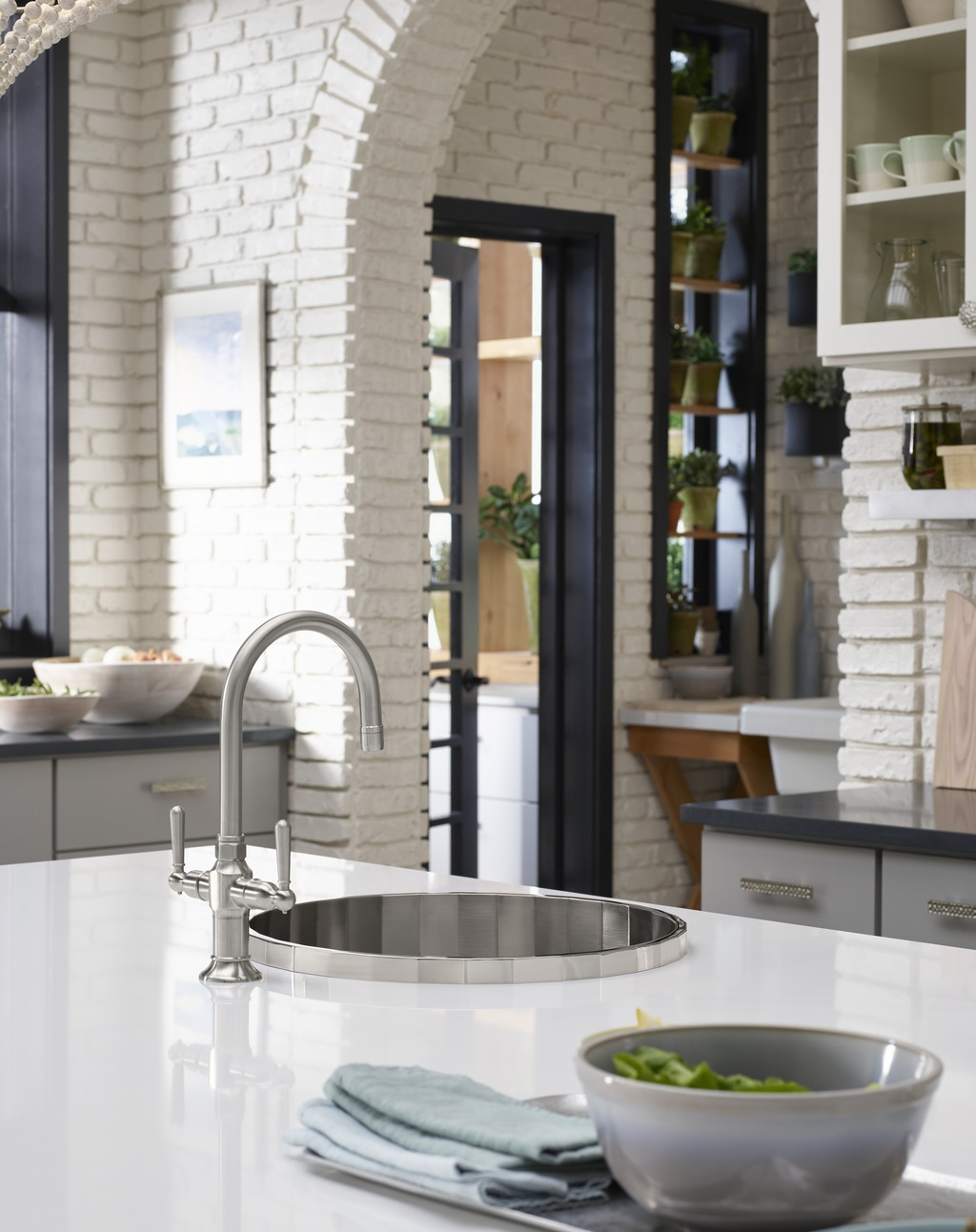 Silestone Iconic White countertop     Cloud Cover OC-25     HiRise Bar Sink Faucet     Brinx Bar Sink     Soft whites come together in the form of creamy quartz countertops and old-world brick to create an environment that's calm and inviting