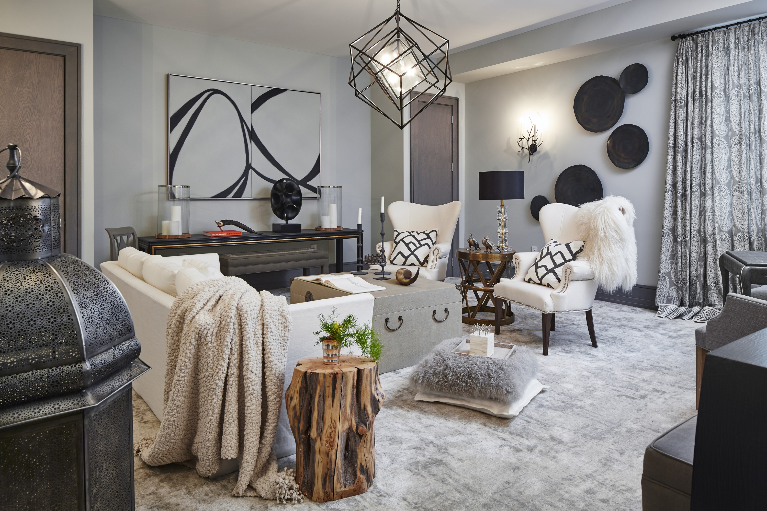 A game room in the lower level is a portrait of cozy, sporting faux fur and heavy knit throws at every turn. Creams, grays and black highlights keep the palette simple and classic.