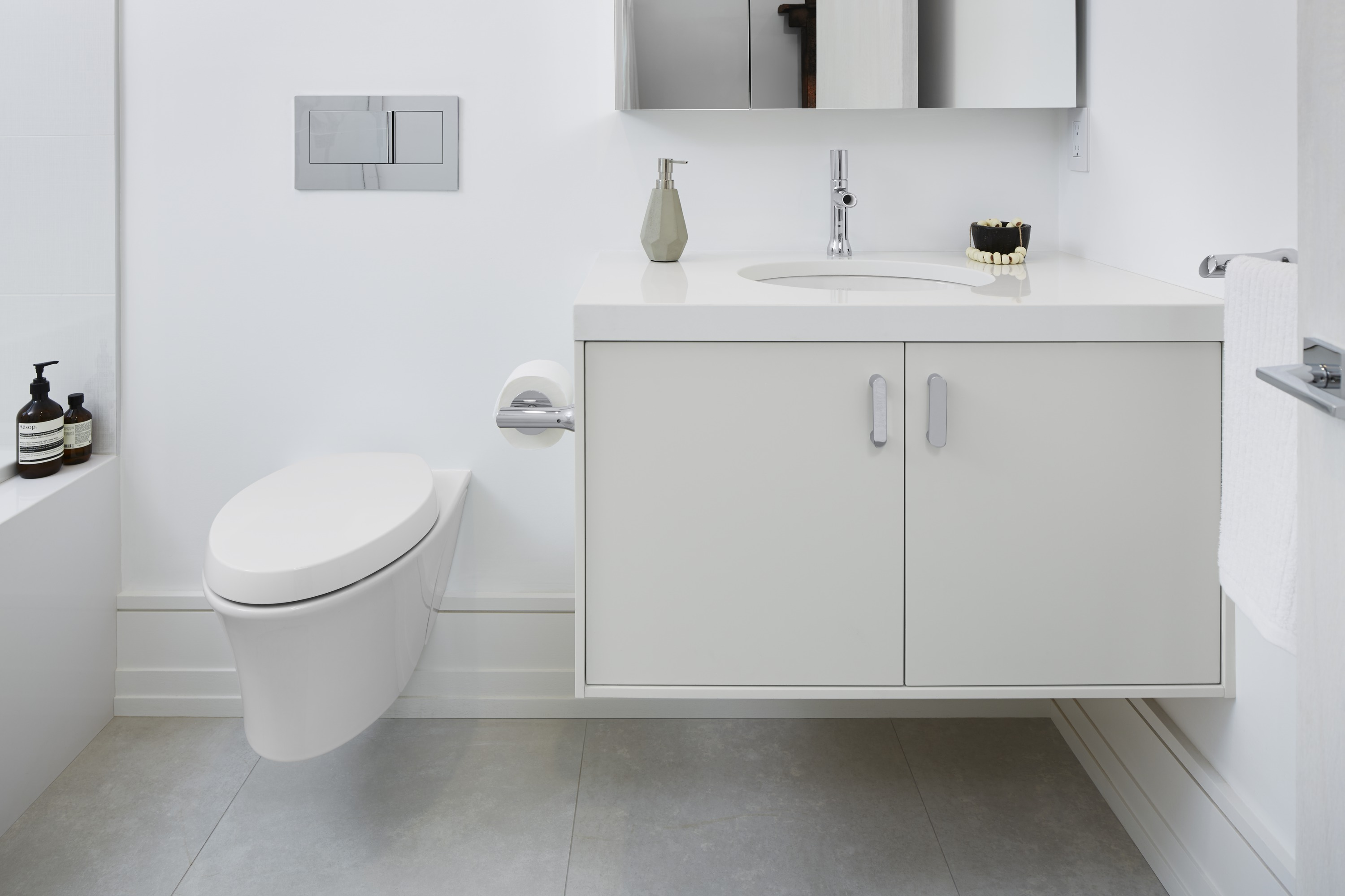 Toobi Faucet     Jute Vanity     Veil Toilet     Veil Flush Plate     Achieving a Zen-like simplicity, the design for this bathroom relies on a wall-hung vanity and toilet to reinforce an open airiness, and faucets that nod to simple bamboo water fountains.