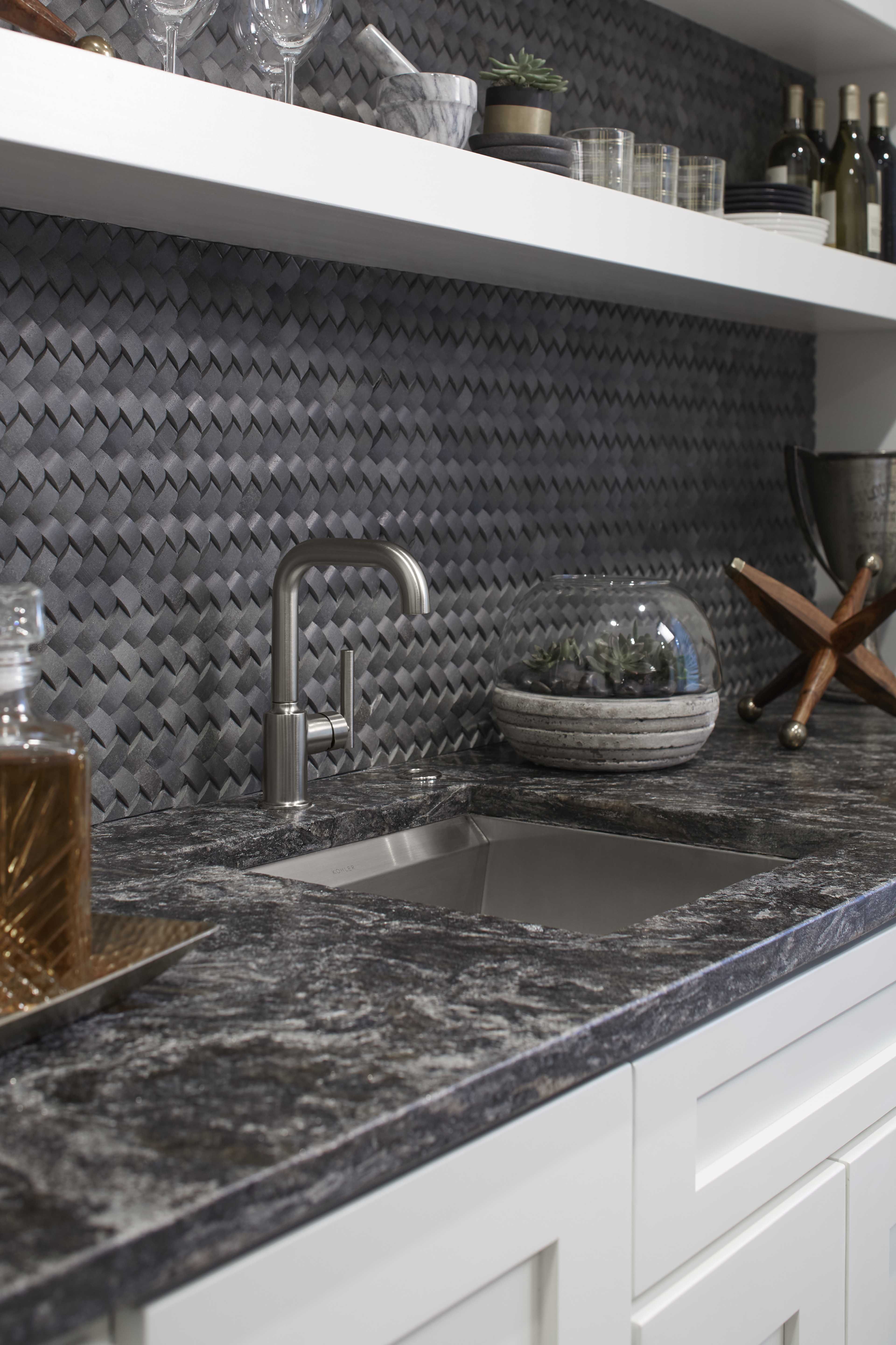 8 Degree Bar Sink     Purist Kitchen Faucet     The sculptural profile of a modern faucet stands out against the basketweave backsplash like a jewel against velvet.