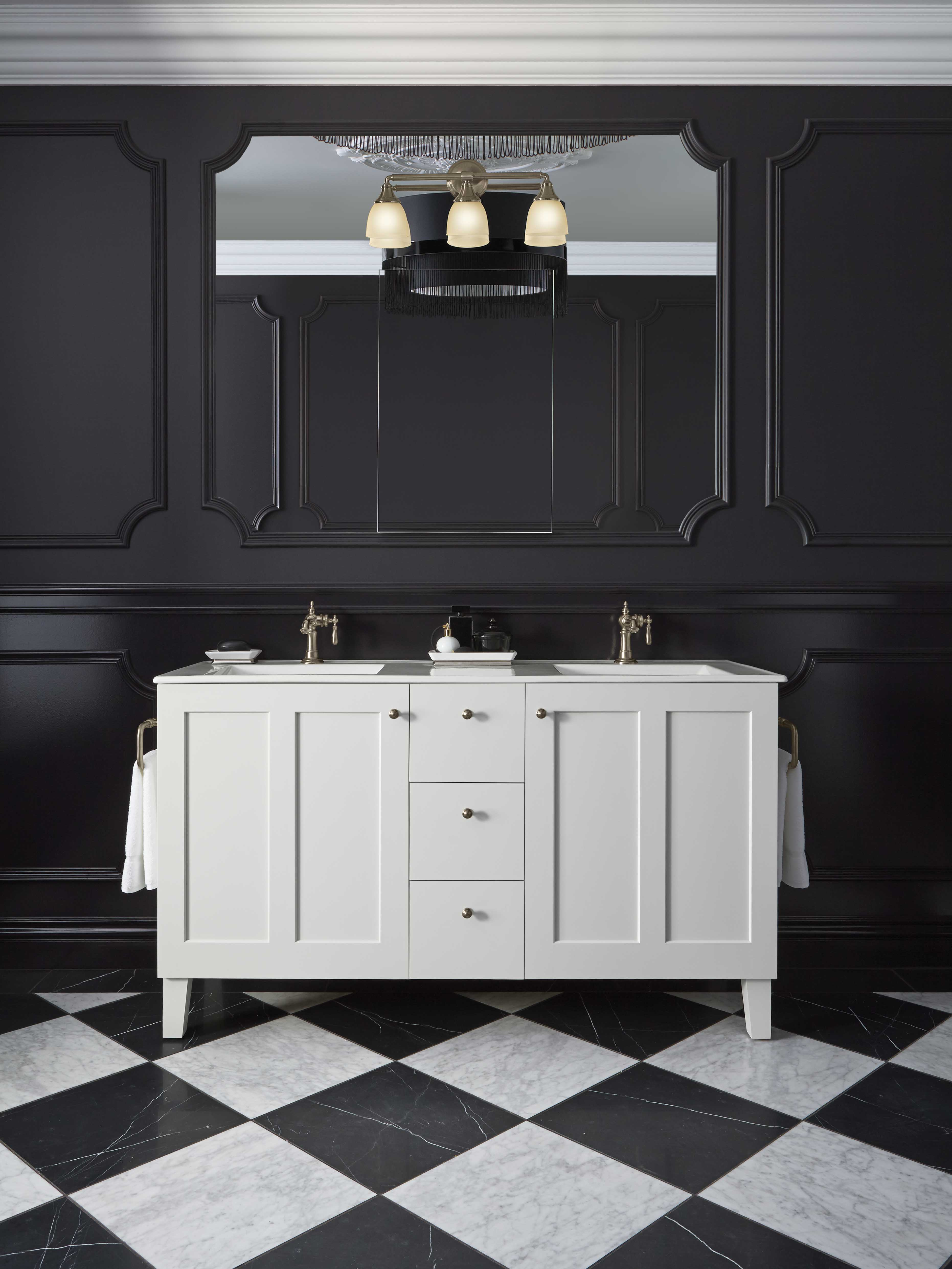 Poplin® Vanity     Artifacts Faucet     This bright white vanity makes a strong style statement against the room's black background.