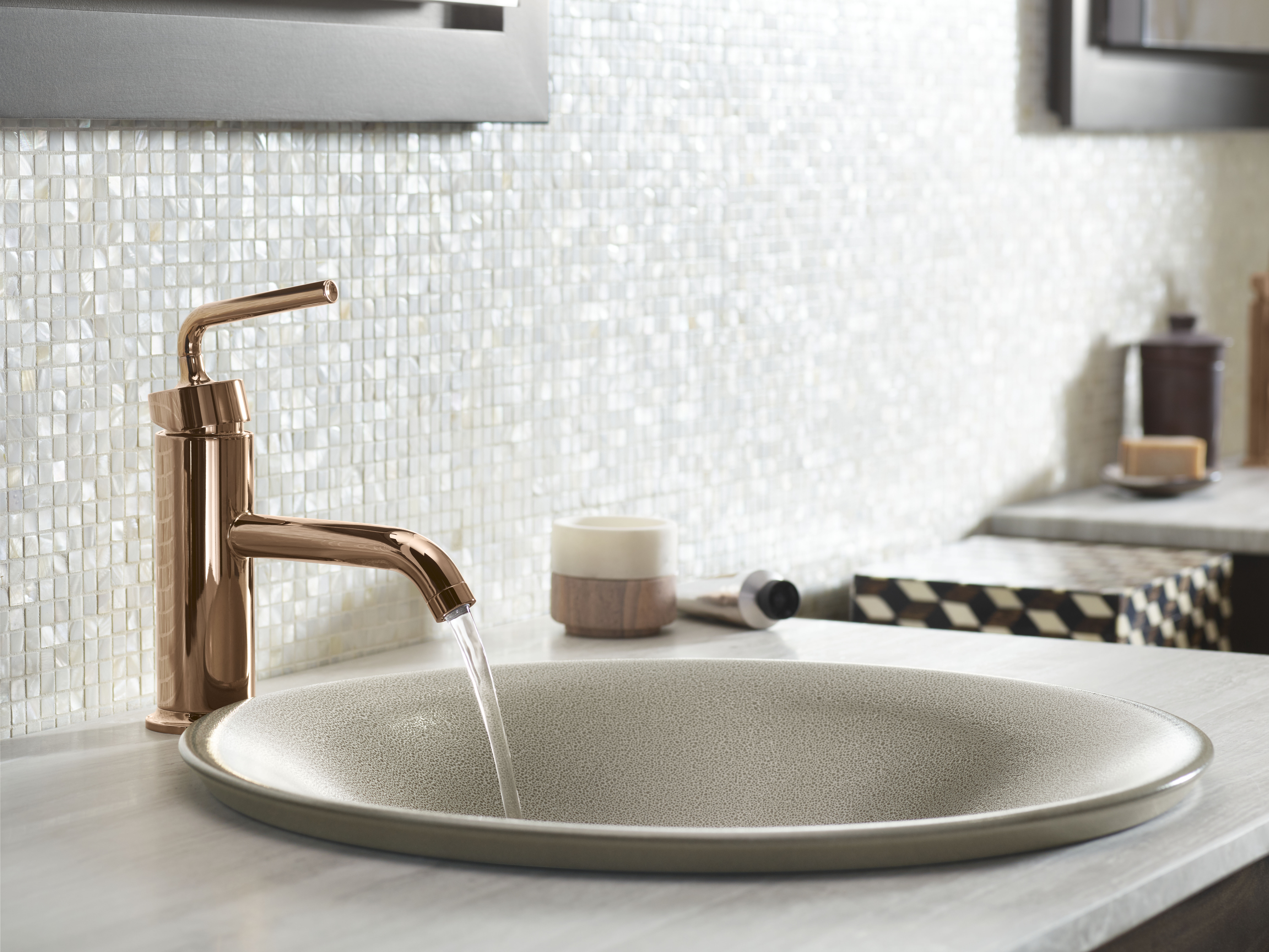 Purist Faucet     Shagreen on Carillon Vessel Sink     With its elegant pink hues, this Polished Rose Gold faucet adds sophistication to this neutral space.