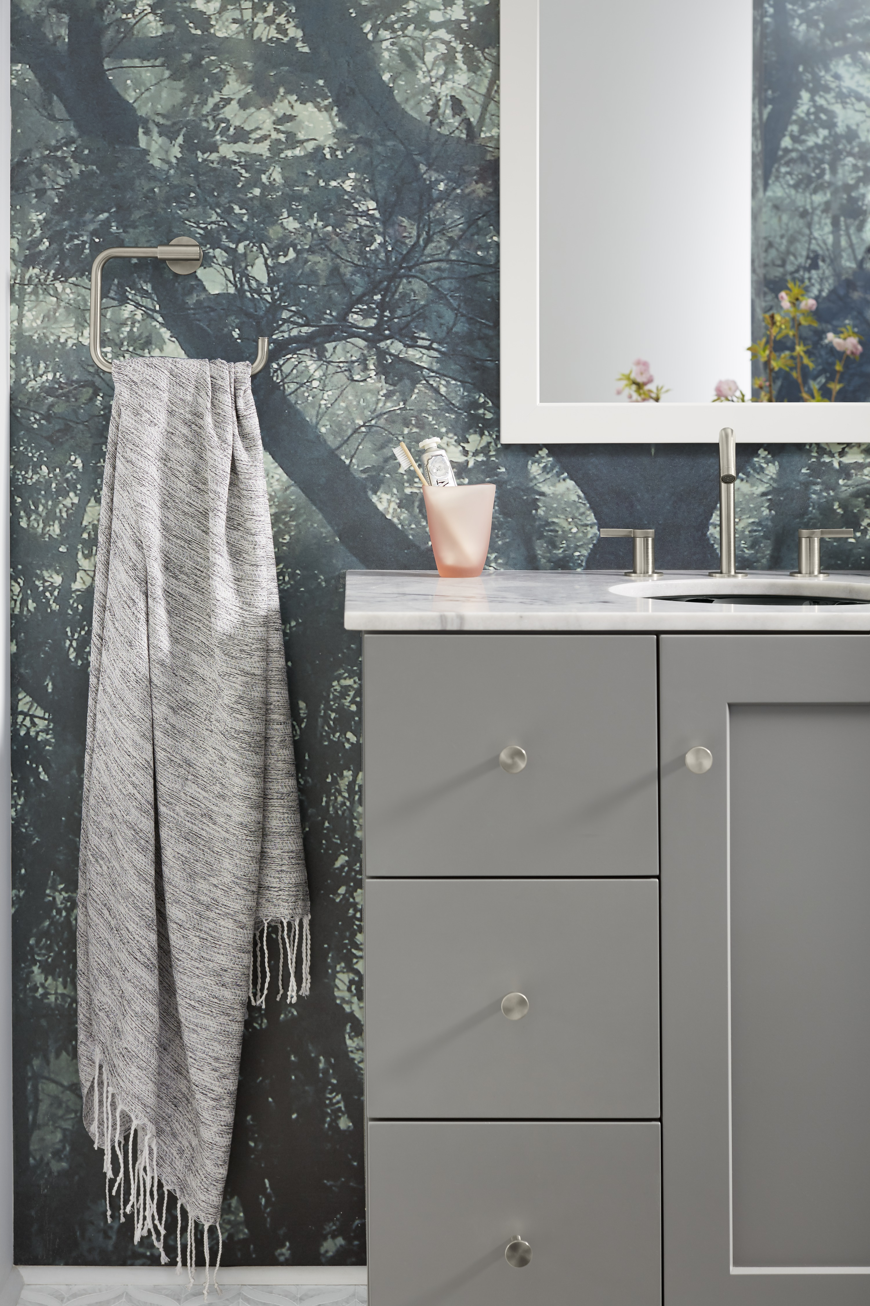 Purist® cabinet knob     Stillness® towel ring     Simple brushed nickel knobs complement the slender, modern faucet and matching towel ring.