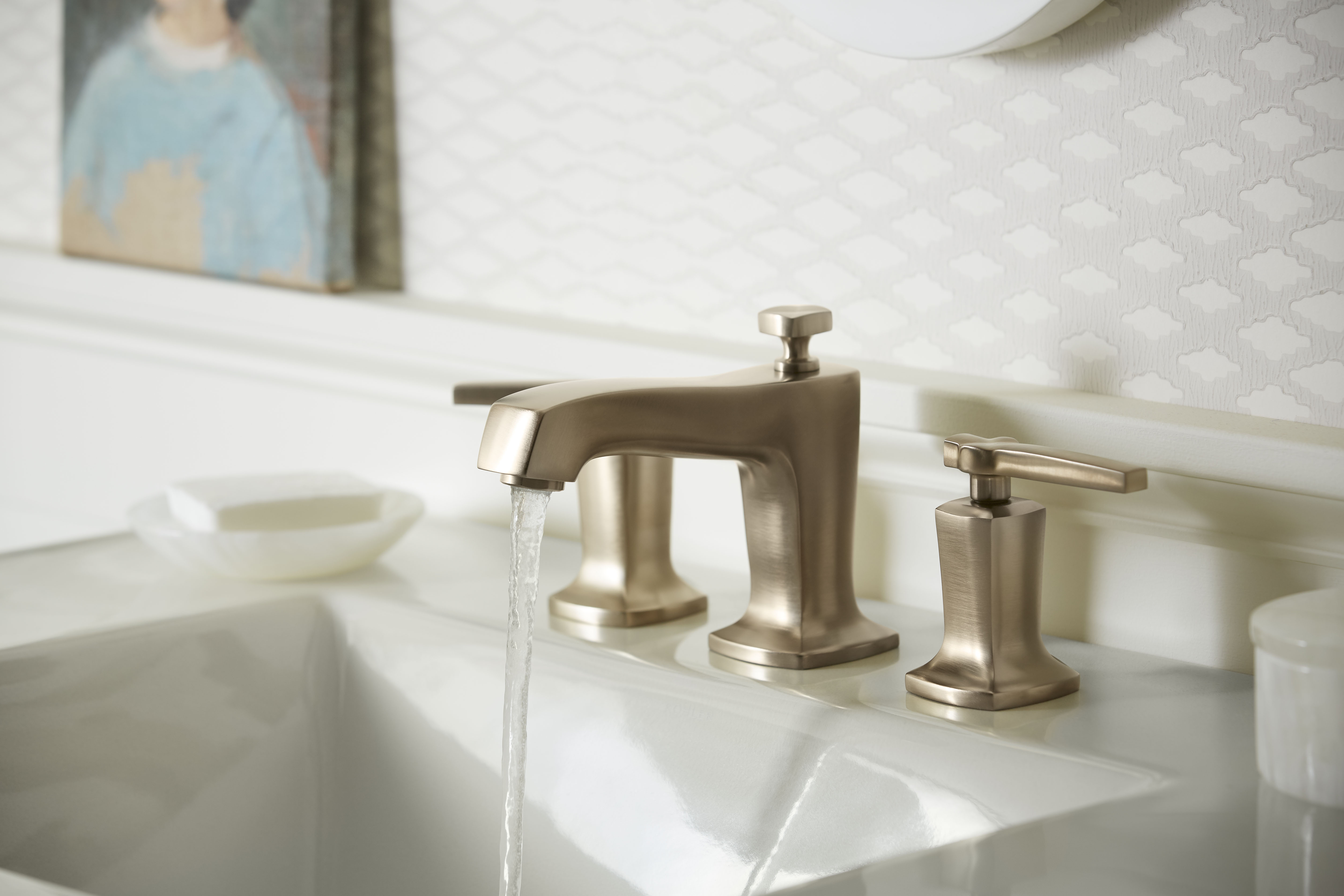 Margaux® Faucet     Ceramic/Impressions® Sink     Warm-toned finishes that make a space feel more inviting are becoming more popular in bathroom design.