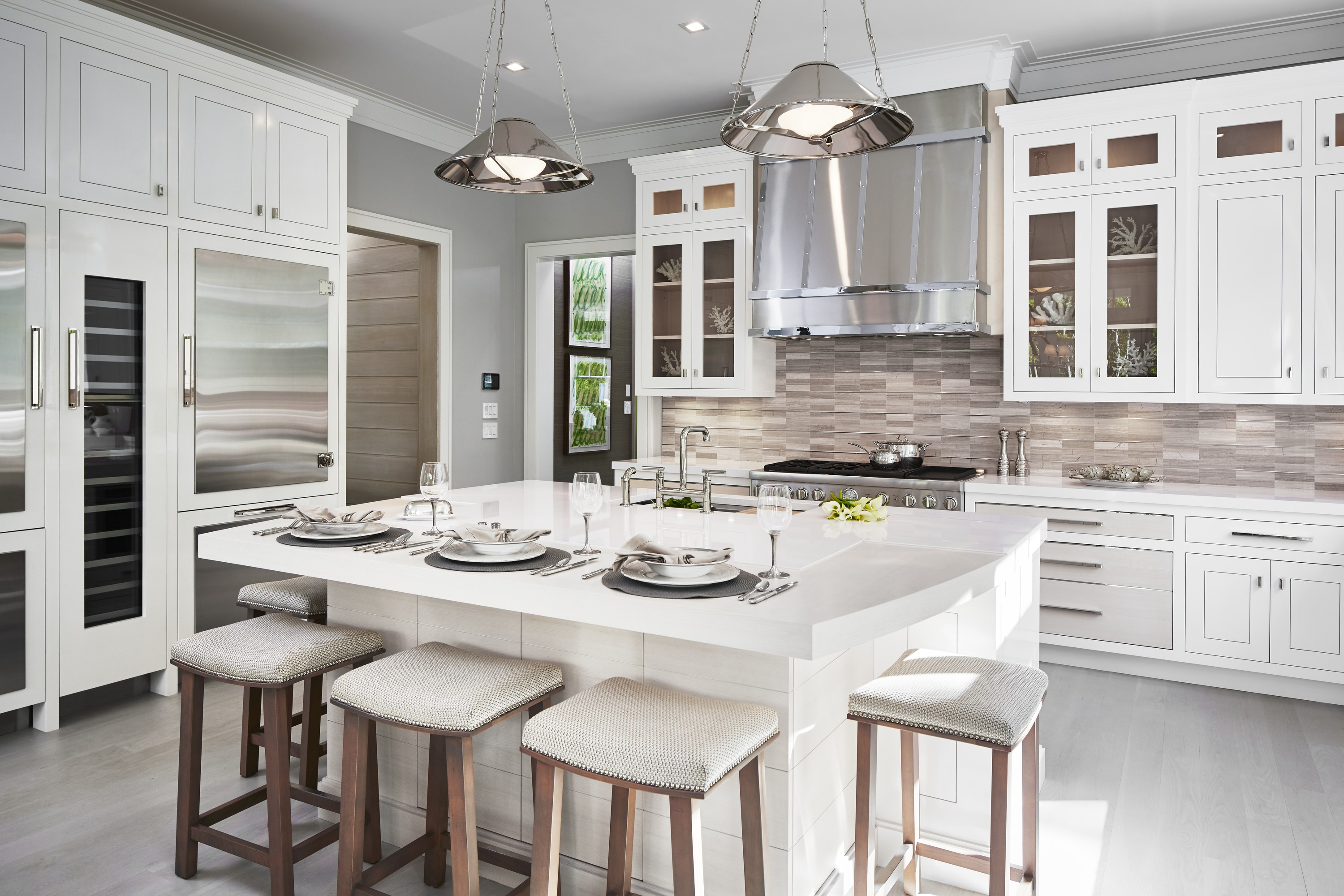 Purist Bridge Kitchen Faucet     Prolific Kitchen Sink     Vault Apron-Front Sink     Dual refrigerators separated by a beverage center flank the island. Together the prep sink, stove and refrigerators create a kitchen triangle for a seamless workflow.