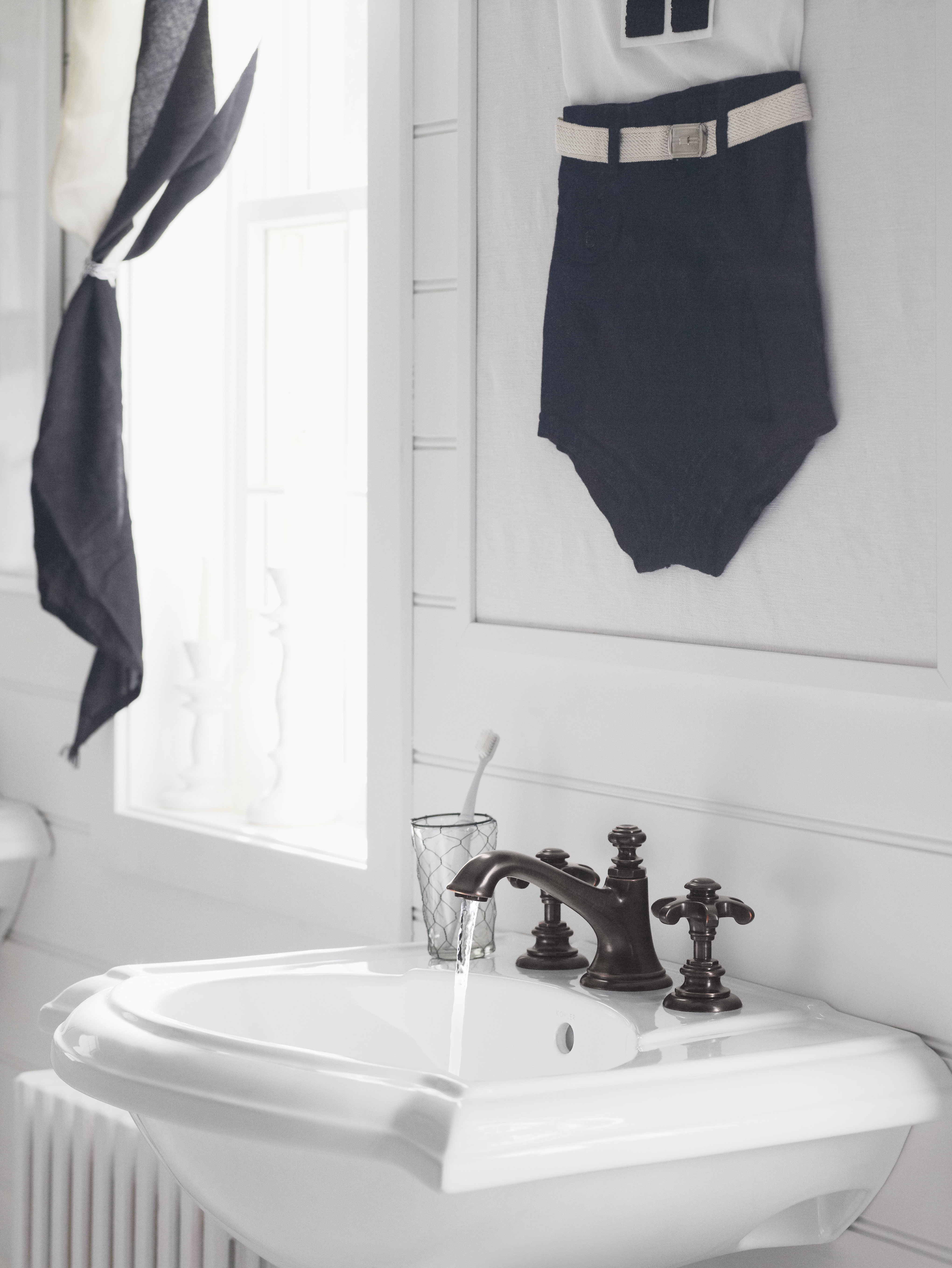 Artifacts Faucet Spout     Artifacts Faucet Handles     Devonshire Sink     The Oil-rubbed Bronze finish on this traditional faucet adds to the simplicity of this color palette, while the vintage-inspired details further the cozy cottage appeal.