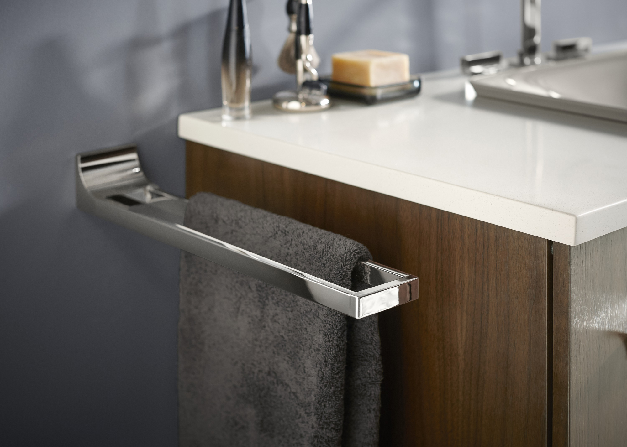Solid/Expressions® vanity top   Loure® towel arm     A slim towel arm provides convenience without cluttering up wall space.