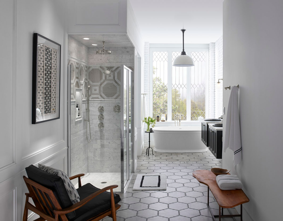Memoirs Freestanding Bath    Damask Vanity    Traditional Round Rainhead   This galley-style bathroom opens to a quiet bathing space flooded with natural light, where a freestanding bath invites you to while away an afternoon.