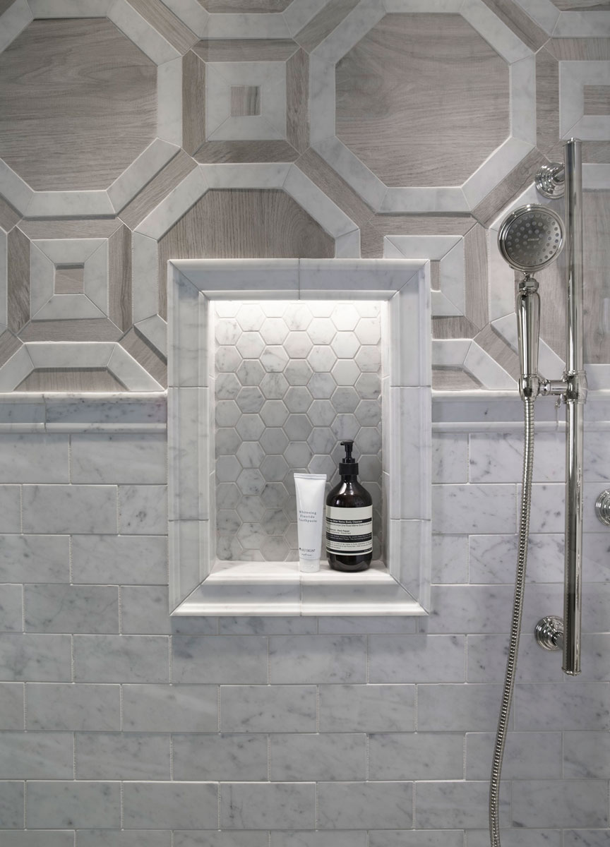 ANN SACKS Carrara Hexagon Tile    Artifacts Handshower    Artifacts Slidebar   Built-in ledges and cubbies help keep the shower clutter-free. Here the shelf is framed with tile to add a formal design element.
