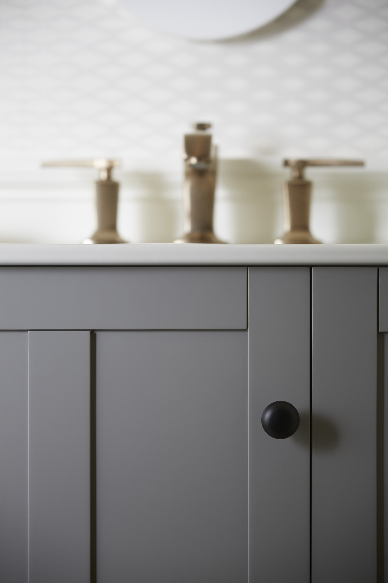 Tresham® vanity    A grey vanity adds to the soft, welcoming feel of this coast-inspired space.