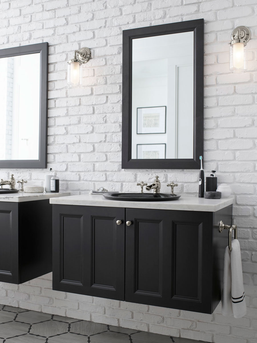 Damask Framed Mirror    Damask Vanity    Artifacts Flume Spout     Artifacts Cross Handles     Artifacts Single Sconce  Two matching mirror and vanity sets in Batiste Black create a dramatic couple's styling area in this mostly white bathroom.
