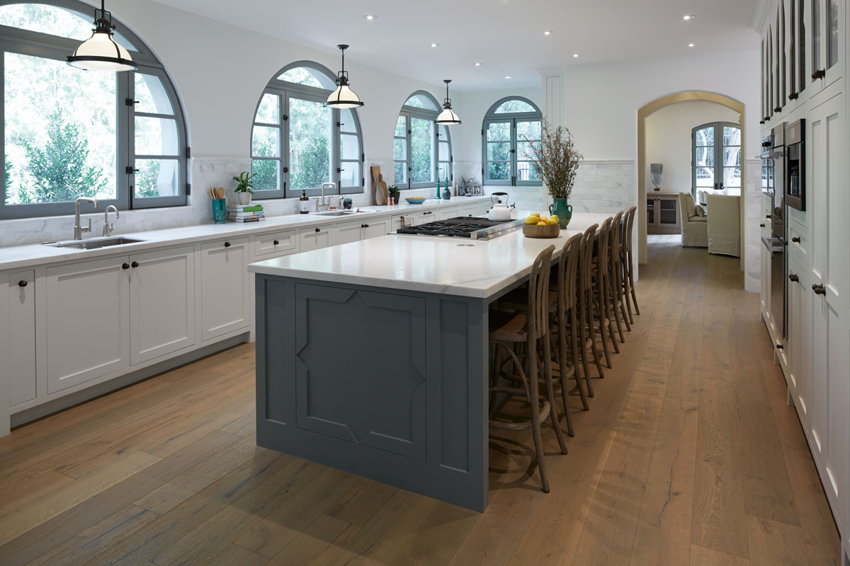 Purist Faucet and Sidespray    Dual Strive Sinks    Purist Pullout Faucet    The expansive kitchen is filled with natural light from arched windows and a pale palette. With side-by-side sinks and bar seating for six, it's a perfect gathering place.