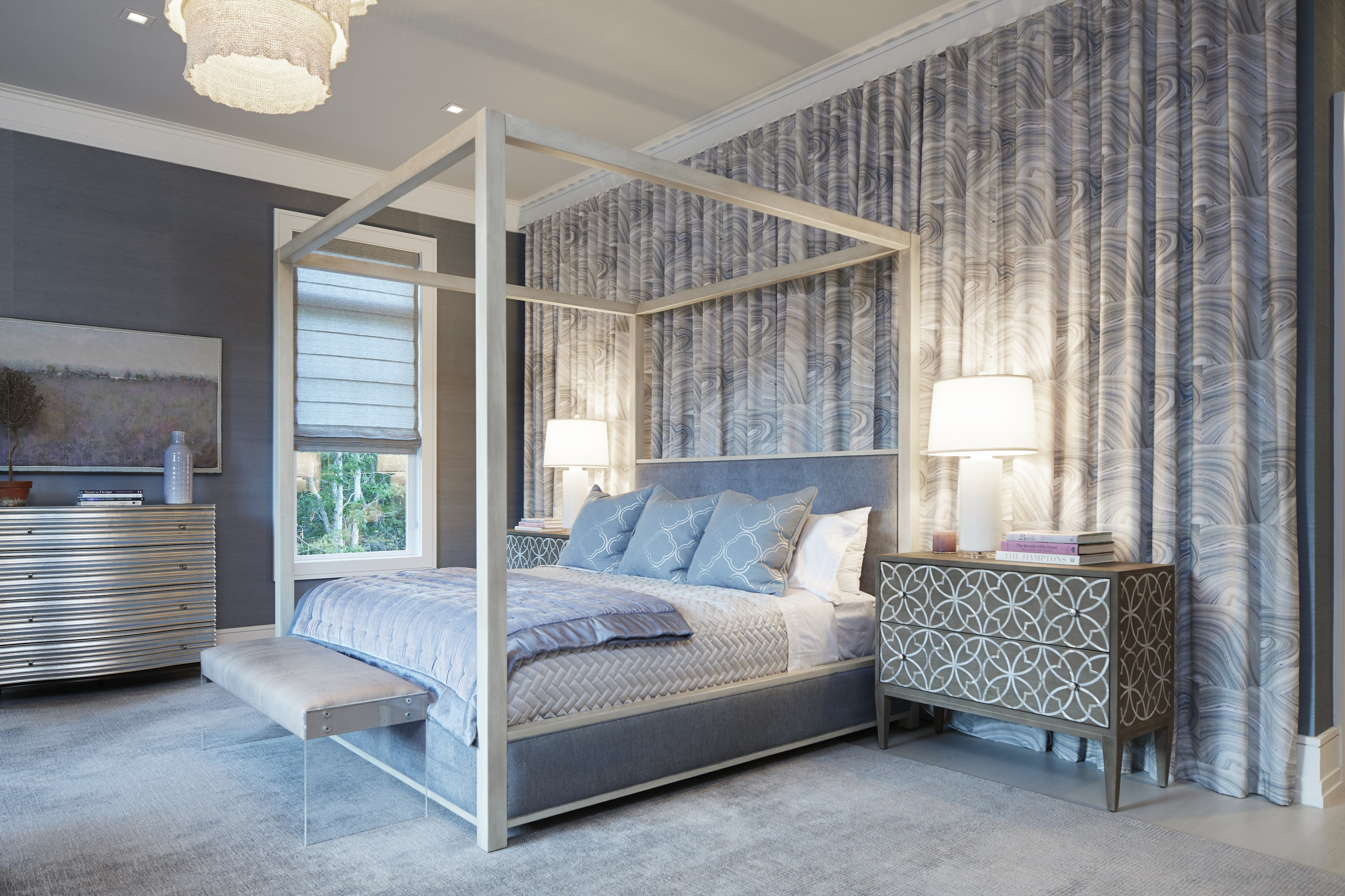In the first-floor master bedroom, layers of color, pattern and texture build to create an environment of serenity punctuated by moments of metallic glamour.