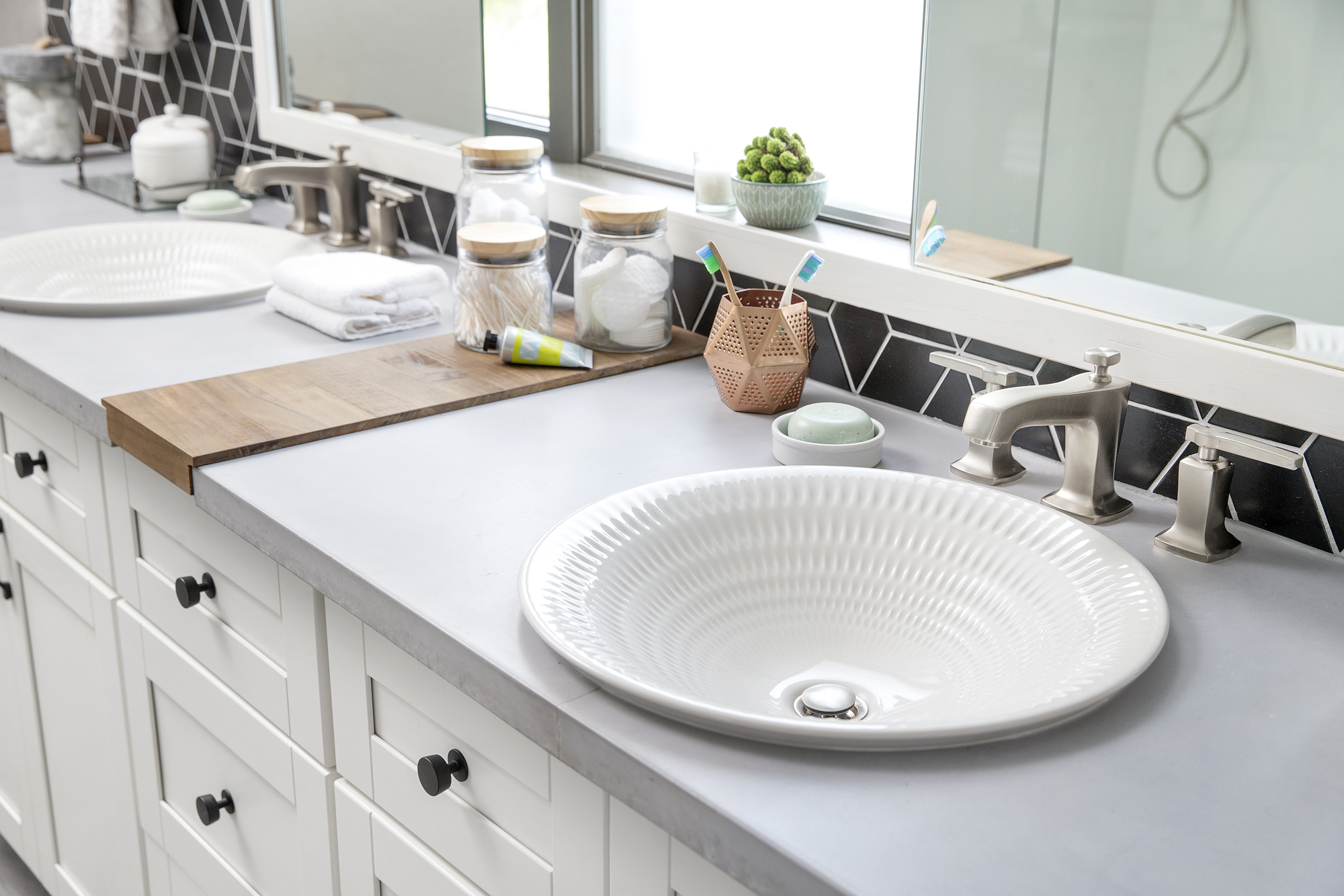 Margaux® faucet   Derring® sink     With a hand-carved texture that accentuates tonal variations in the glaze, side-by-side sinks in soft white give the master bath its organic, polished elegance.
