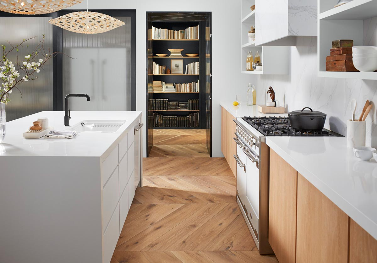 Purist Faucet     Riverby Sink      An island tasking space with sink and faucet is aptly positioned across from a cooking station with widespread countertops–making workflow seamless and approachable.