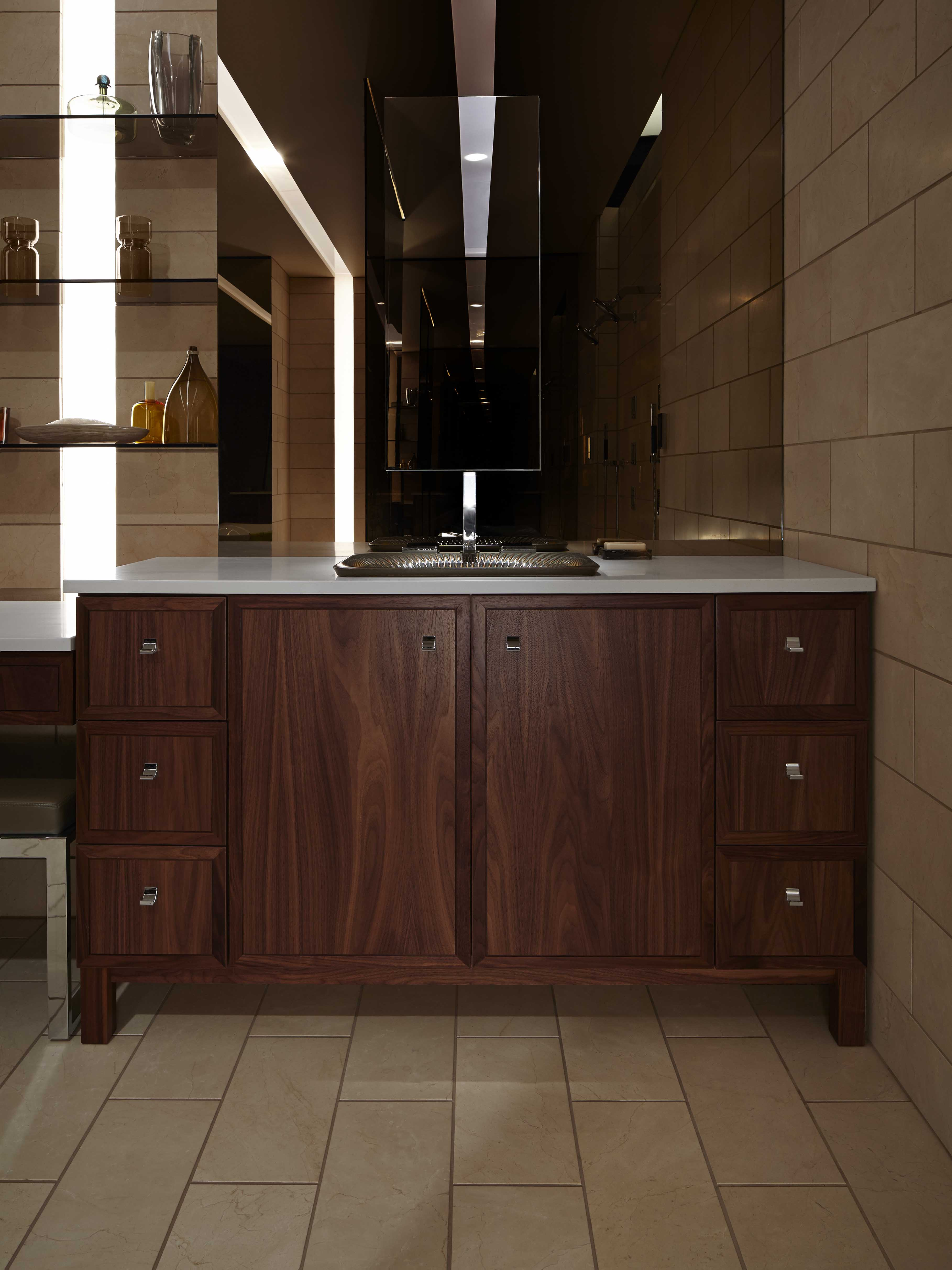 Jacquard® Vanity     Loure® Faucet     The dark finish on this vanity blends seamlessly with the room's moody atmosphere.