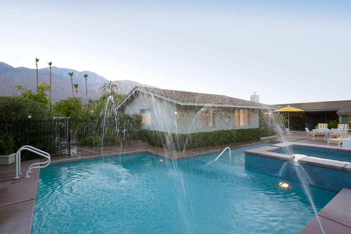The backyard features a pool with unique fountain sprays, a hot tub and an adjacent lounge area for family cookouts and pool parties.