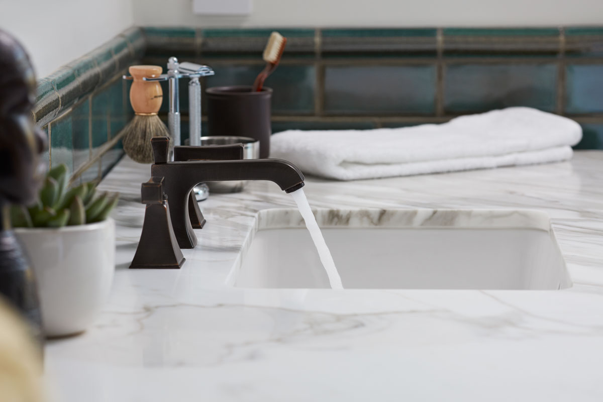 Memoirs Faucet    Ladena Sink    Oil-rubbed bronze faucet finishes pick up the earthy rich tones of the wall tile and combine with the marble counters for an old-world feel.