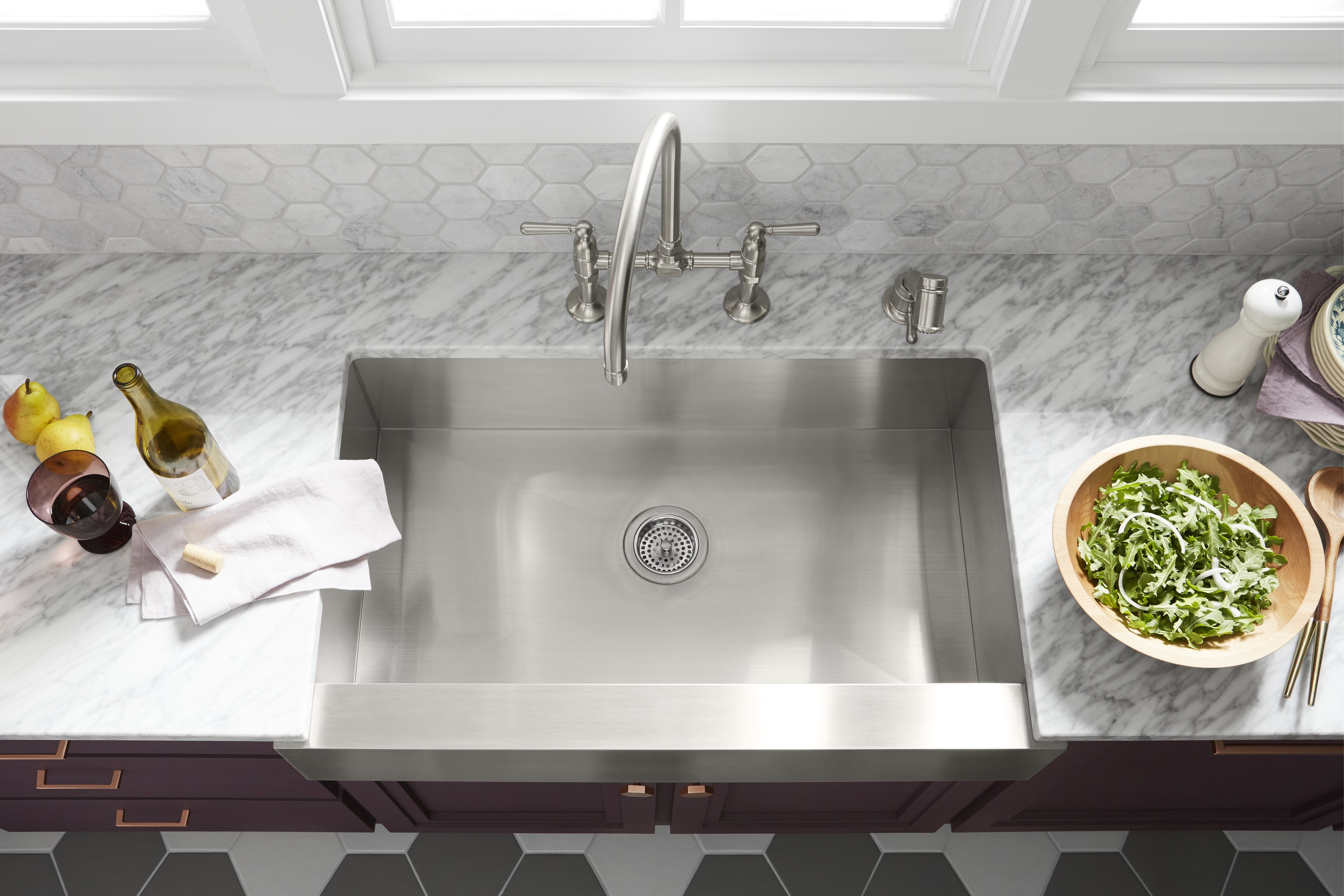 HiRise™ bridge kitchen faucet     Vault™ under-mount apron-front kitchen sink     A single-basin sink features tightly angled corners to maximize workspace.