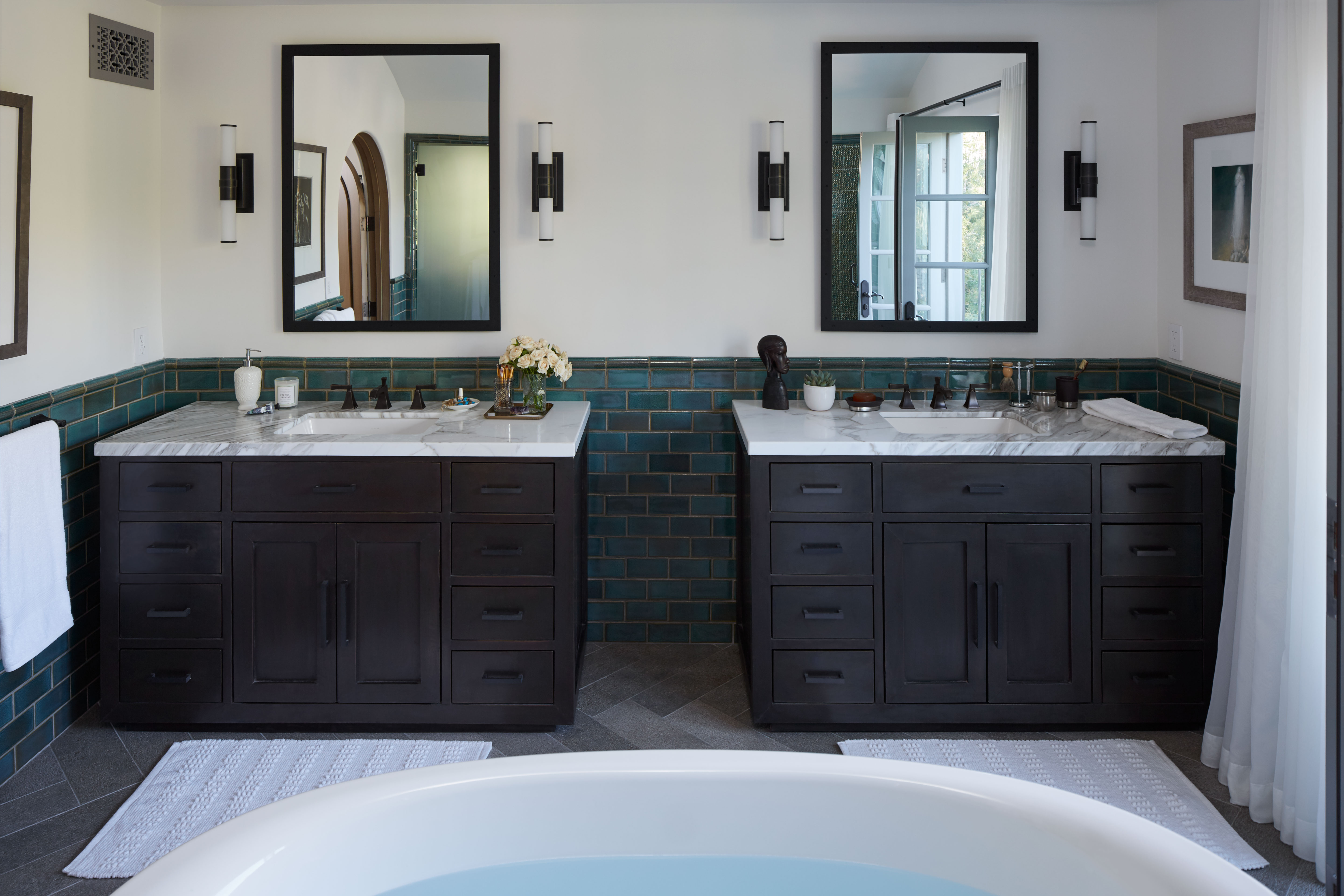 Memoirs Faucet    Ladena Sink    Memoirs Towel Bar    Symmetrical styling spaces complete the master bath with storage-rich vanities and framed medicine cabinets. Dark wood and faucet finishes complement the home's Spanish style.